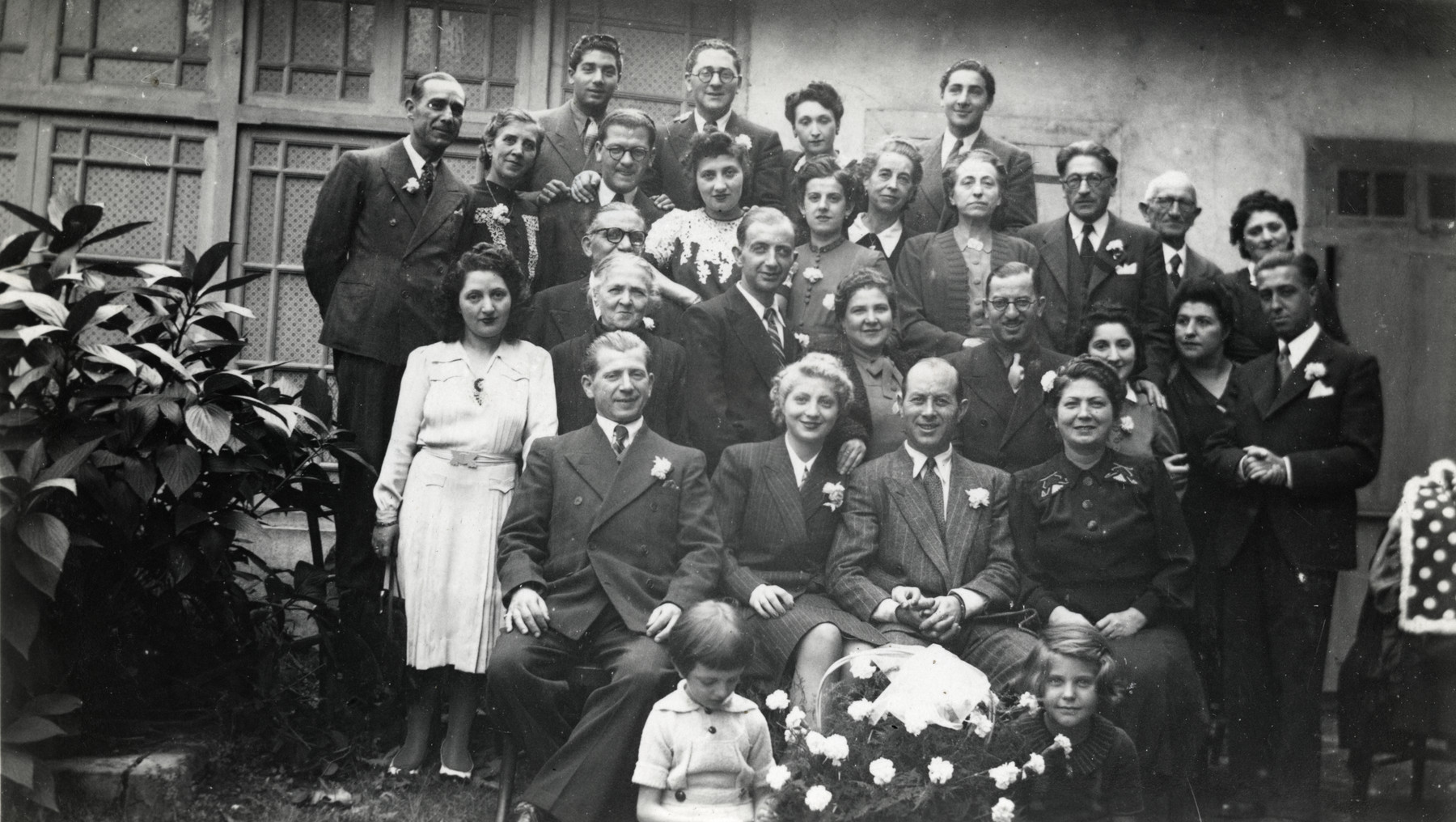 Family and friends, among them members of the Cassorla family gather for a celebration [probably in Bitola].