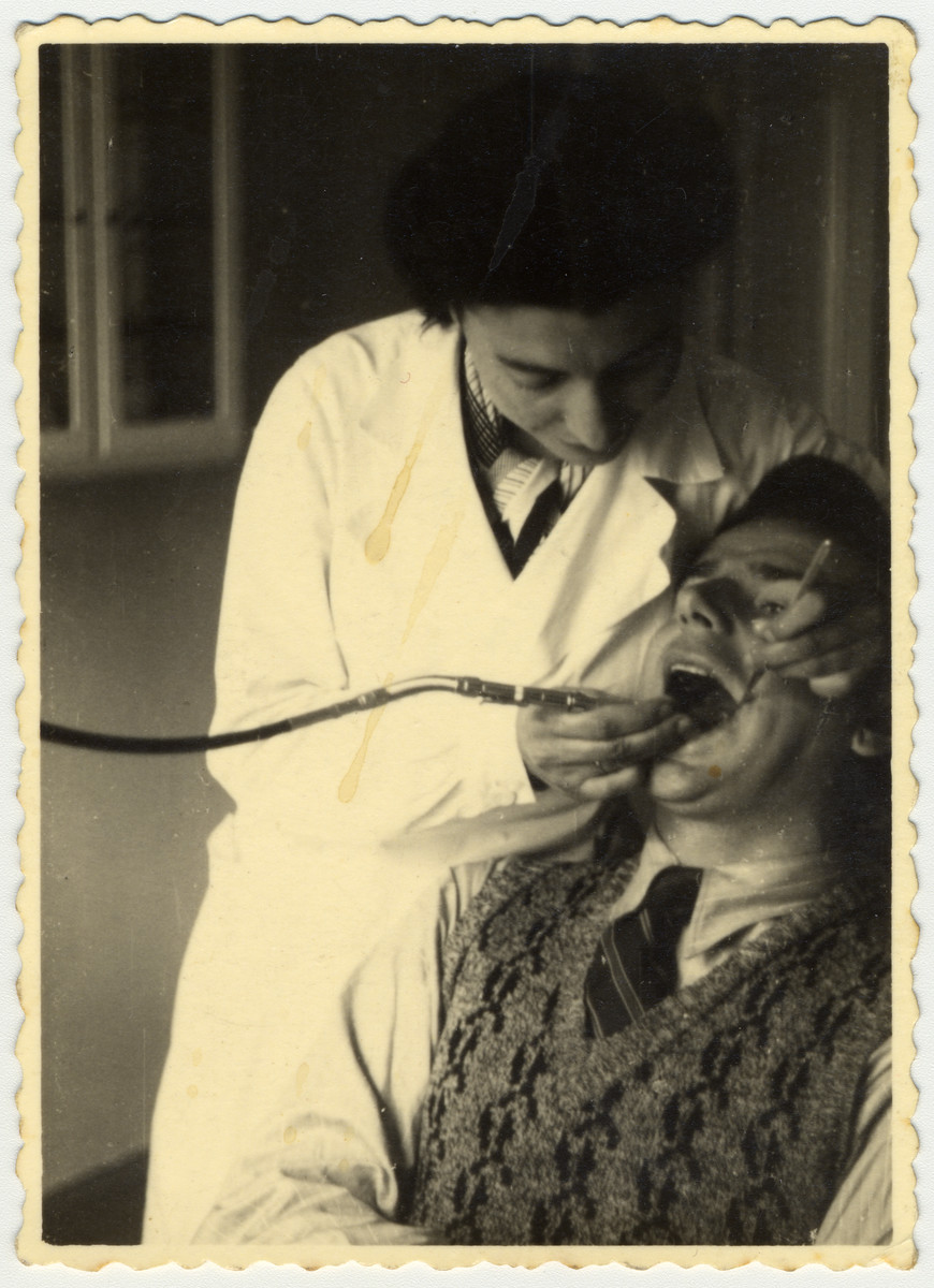 Ella (nee Schapiro) Javorkovsky, the aunt of the donor, performs dentistry on a patient in Riga, Latvia.  She was killed by the Einsatzgruppen in the forests outside Riga in November 1941.