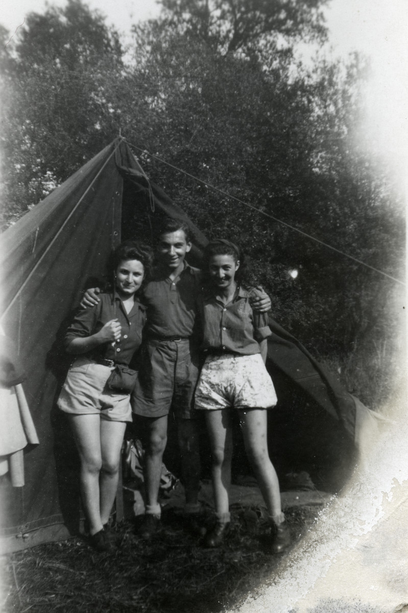 Three members of Kvutzot Borochov go camping outside of Paris.  Lisa Rosensweig is pictured on the left and Elena Weisbrot is on the right.