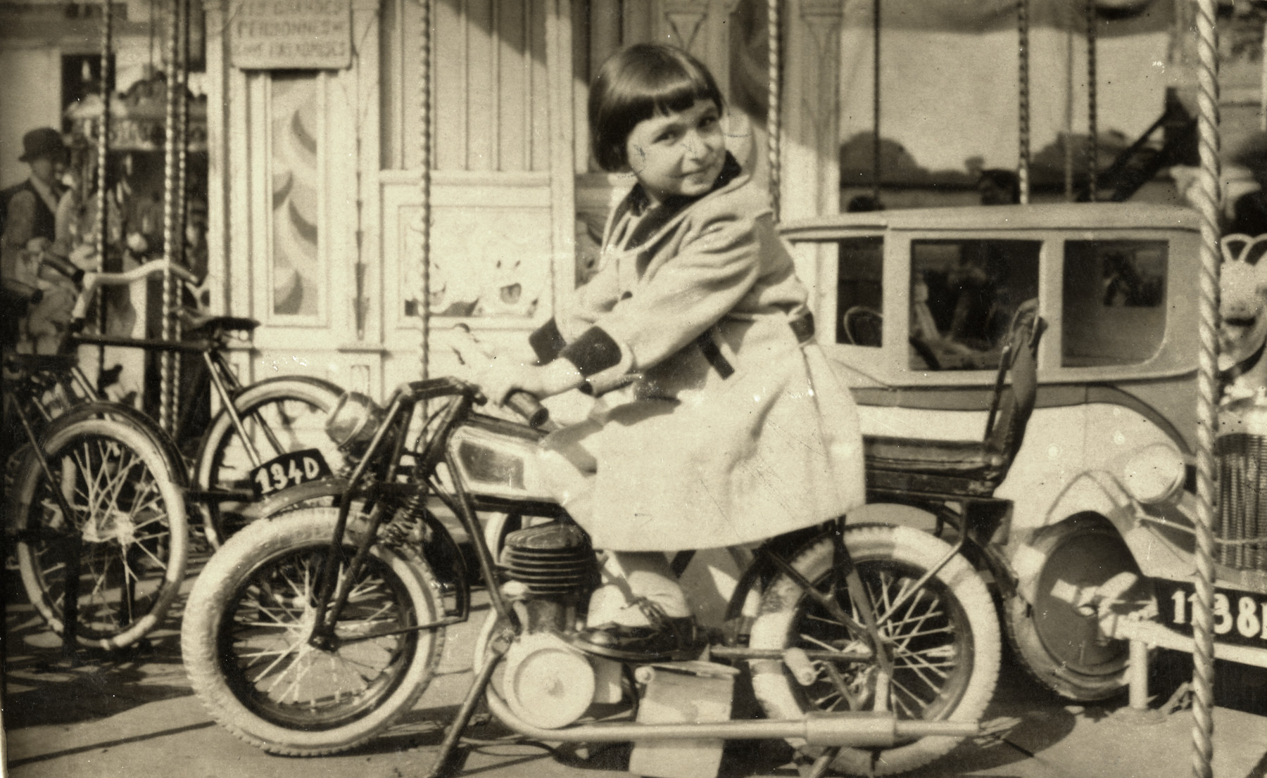 Lisa Rosensweig poses on a small bicycle.