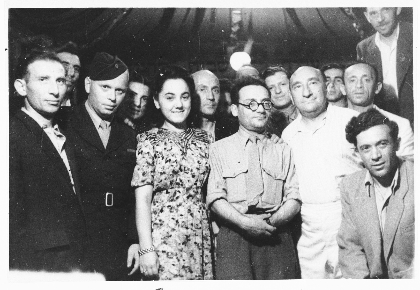 Group portrait of Jewish displaced persons in the Pocking camp.  Samuel Tick (the leader of Farband) is on the far left.  His wife Faiga Milchberg Tick is in the center.