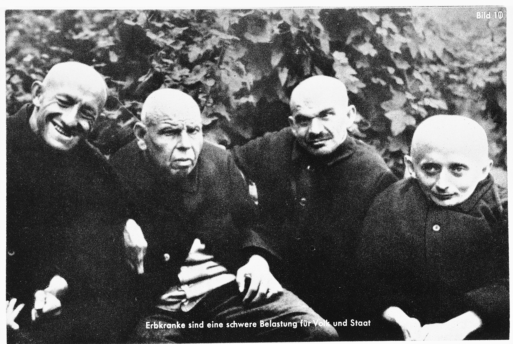 "Nazi propaganda showing four disabled men.  The original caption reads: ""Hereditary illnesses are a heavy burden for the people and the state"""