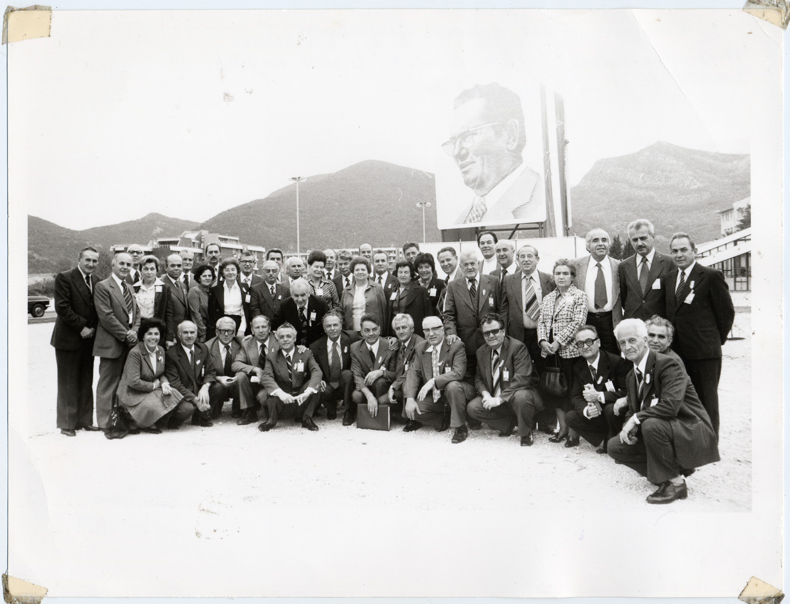 Members of the 8th Congress of Yugoslav Resistance Fighters in Budva, Montenegro pose in front of a large banner depicting Josip Broz Tito.  Among those pictured is Jamila Kolonomos (second row, eleventh from the left).