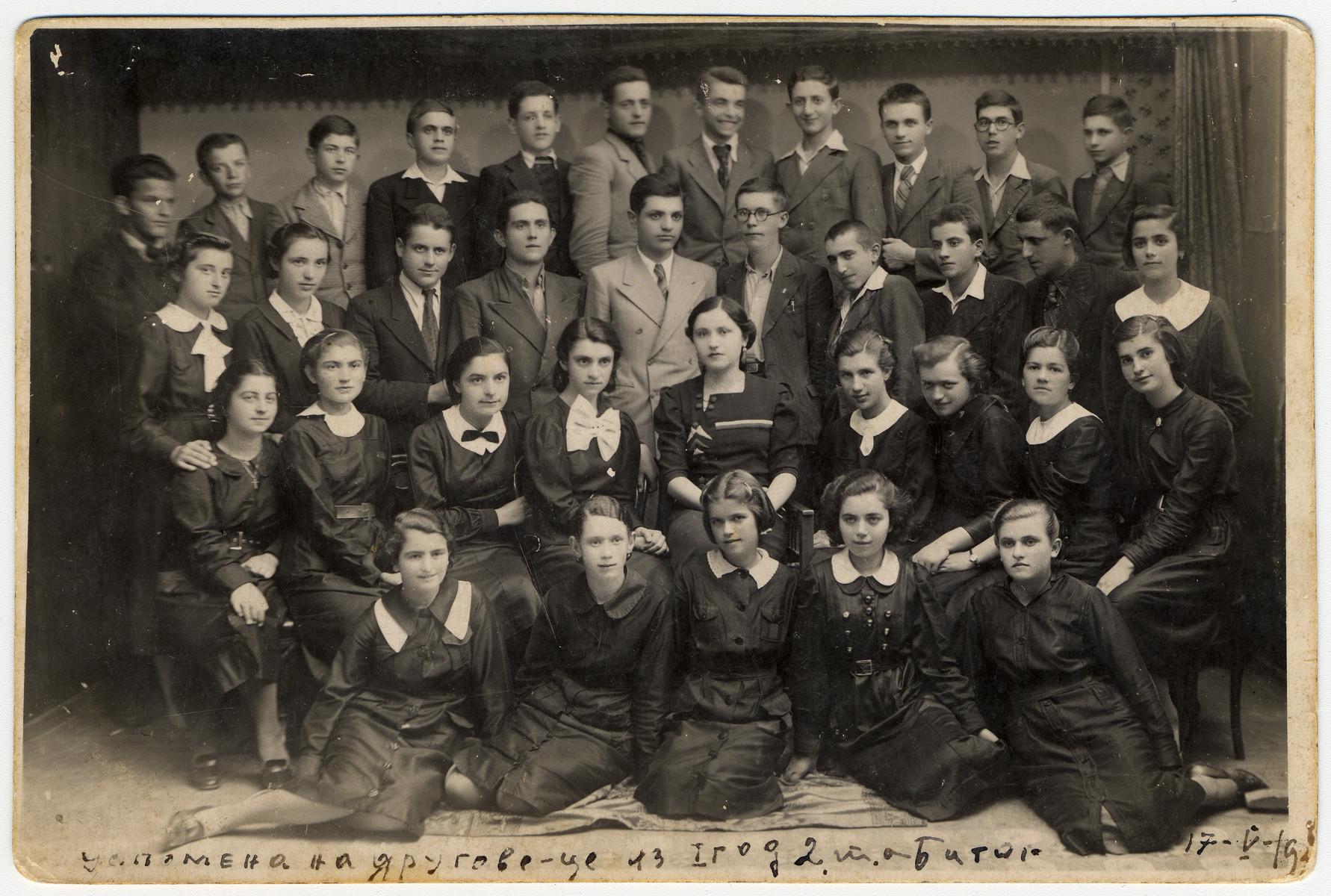 Group portrait of students in a business school.  Among those pictured are (front row, left to right): Jamila Kolonomos, Roza Kamhi, Redjina Shami, Rebeka Pardo, Marie Romano;  (third or fourth row?): Joco Beraha, and Leon Faradji.