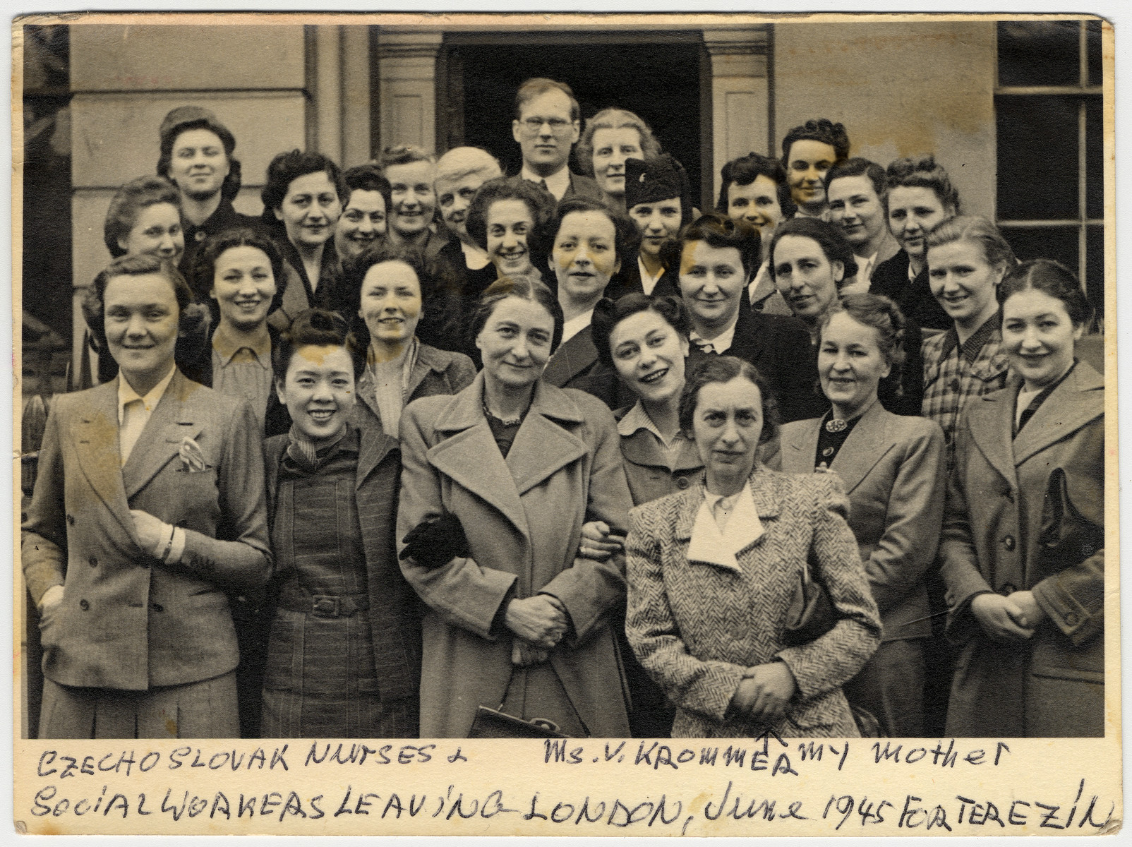 A group of Czech and British trained social workers and nurses prepares to leave London for Theresienstadt to provide assistance to survivors.  Pictured in the front in the tweed suit is V. Krommer, mother of the donor.