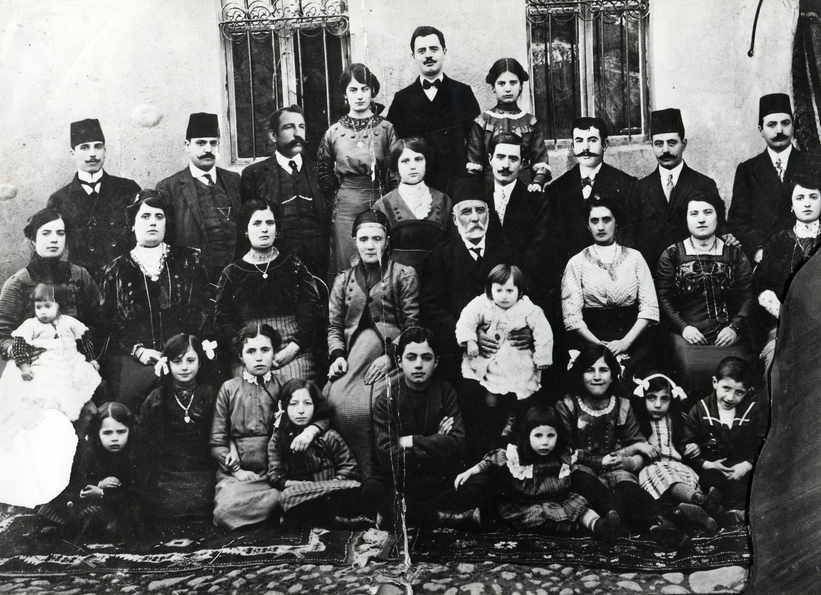 A large extended Macedonian Jewish family.  Pictured is the family of Salamon Kolonomos, who immigrated to Monastir from Greece with his brothers  Kalef and Mentesh.  Kalef and Mentesh emigrated to France before the start of WWI.