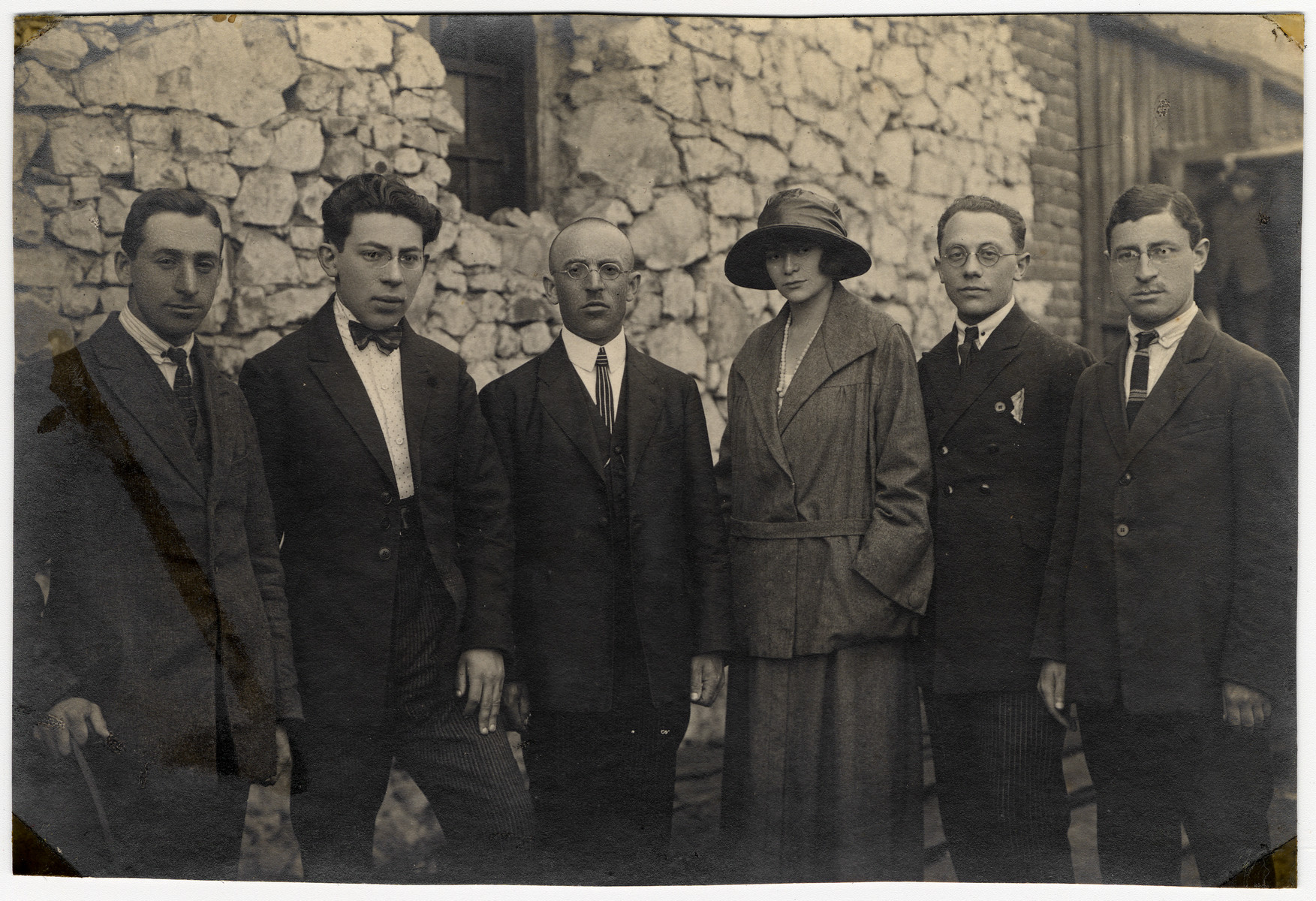 Group portrait of young adults in Belgium.  Among those pictured is Samuel Glasberg (second from right).