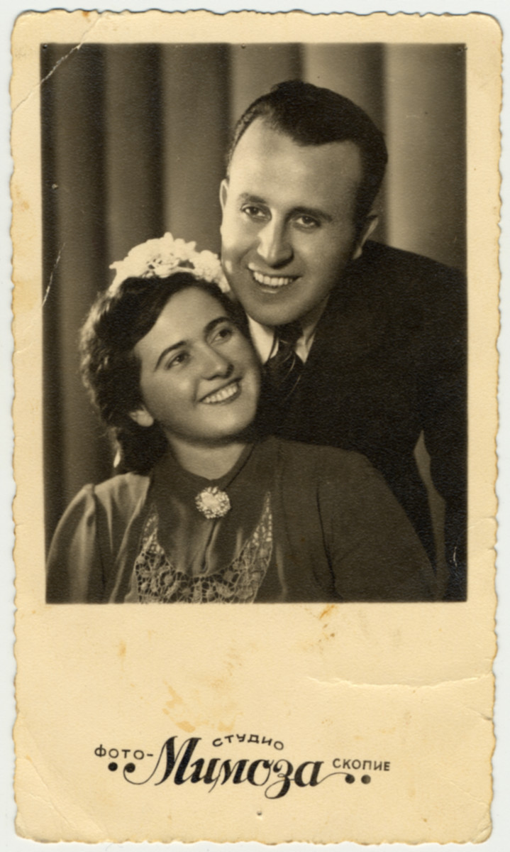 """Wedding portrait of a Macedonian Jewish couple.  Pictured are Bela Kolonomos (sister of the donor) and her husband, Moise Kassorla, on the day or their marriage.    The inscription on the back (in French) reads, """"To our dear Politina, a souvenir of our marriage.  Bella and Moise, Skopje 16-11-41)."""""""