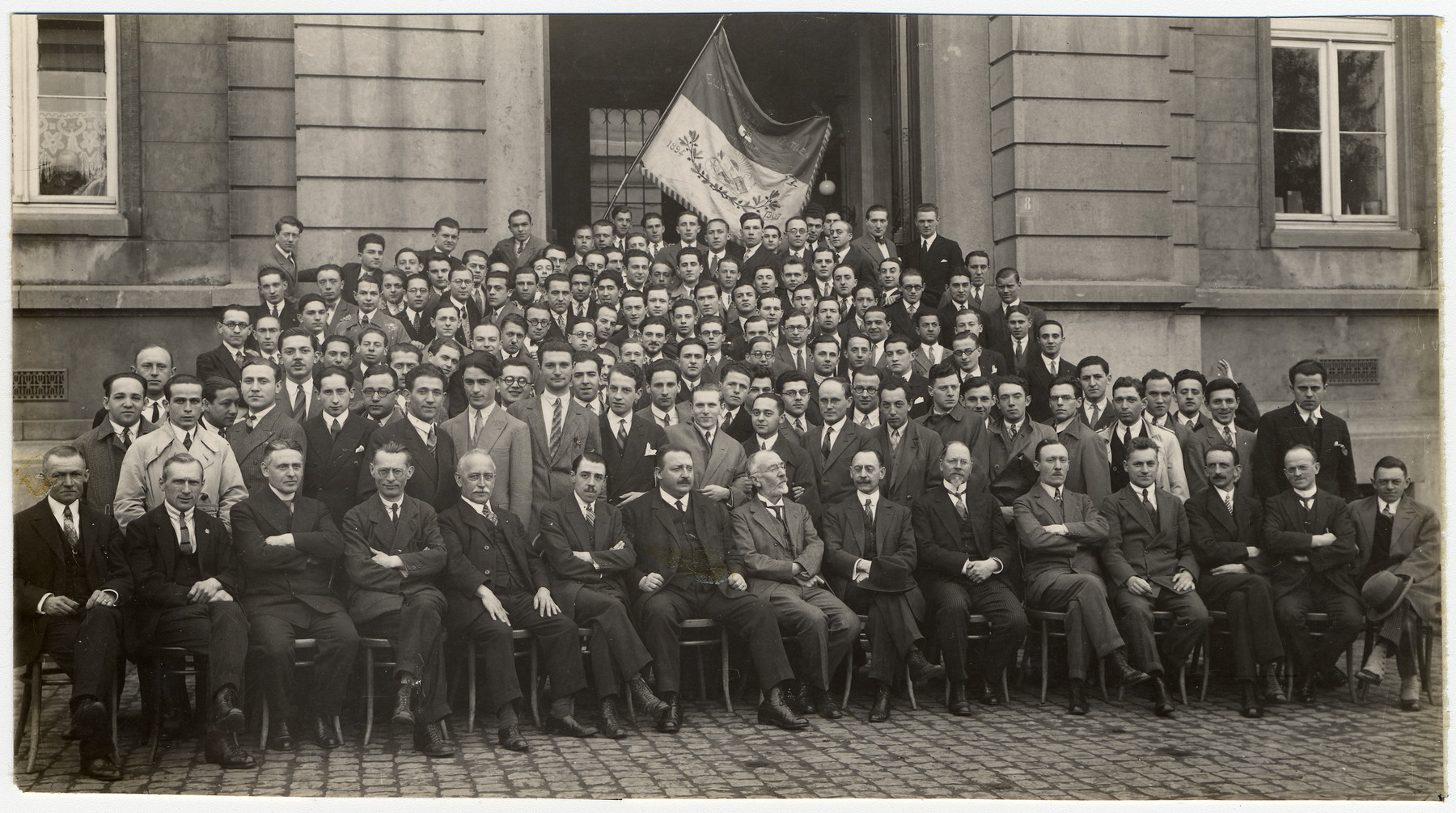 Grou portrait of faculty and students at the technical university in Verviers, Belgium.  Samuel Glasberg is pictured in the back row, fourth from the right.