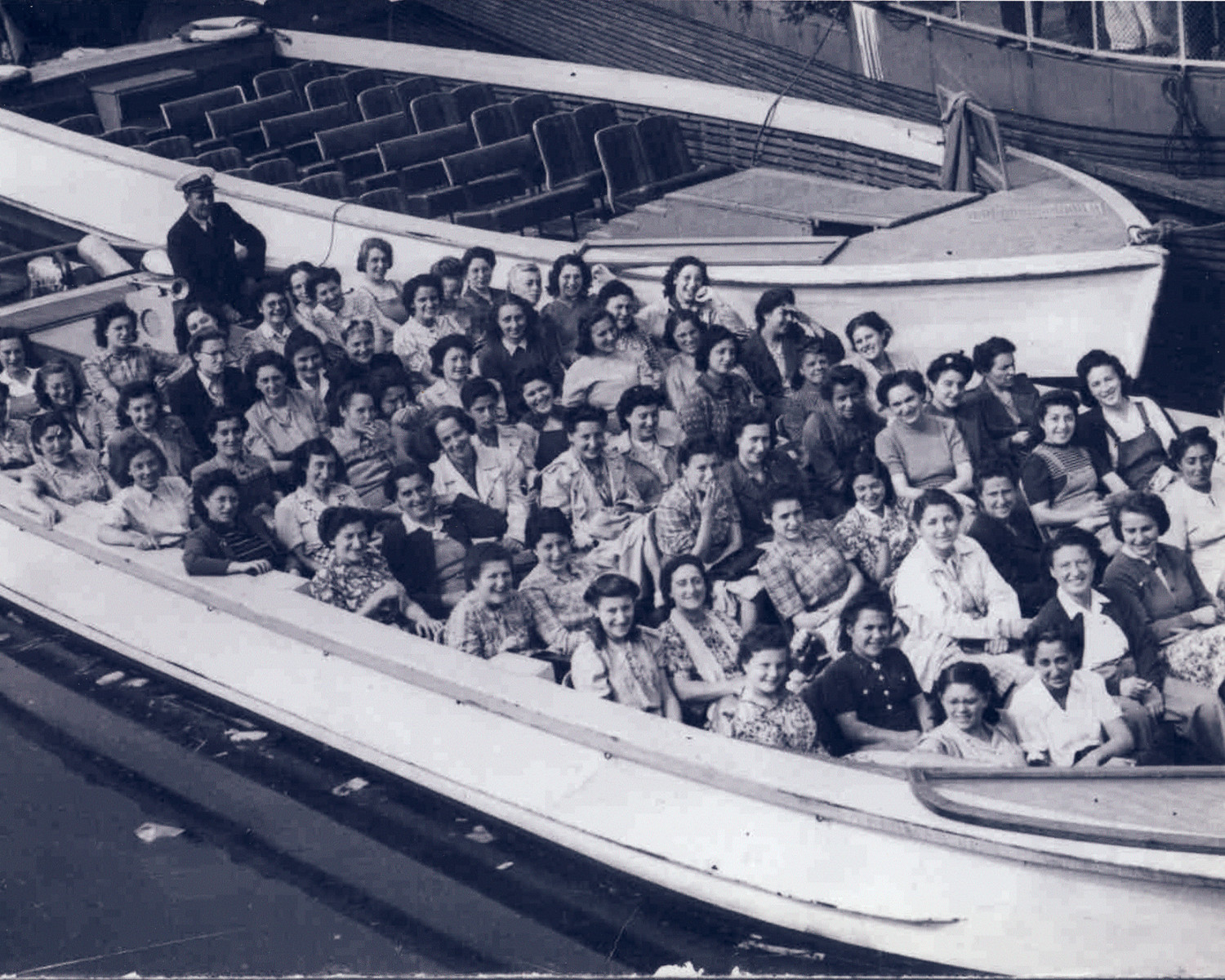 "Female Dutch Jewish survivors who were part of the ""Philips"" group go for a boat ride in Goteborg, Sweden.  Among those pictured are Lore Wertheim, Rita Noah, Betty Koppel, Ilse Heyman, Inge Weinberg, and Trude Leser.  The Kupferschlag sisters have been tentatively identified."
