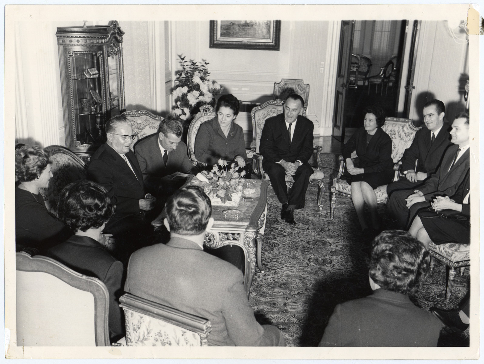 "Reception at the ""Maison Blanche,"" residence of Josip Broz Tito.   Seated at the right is Jamila Kolonomos."
