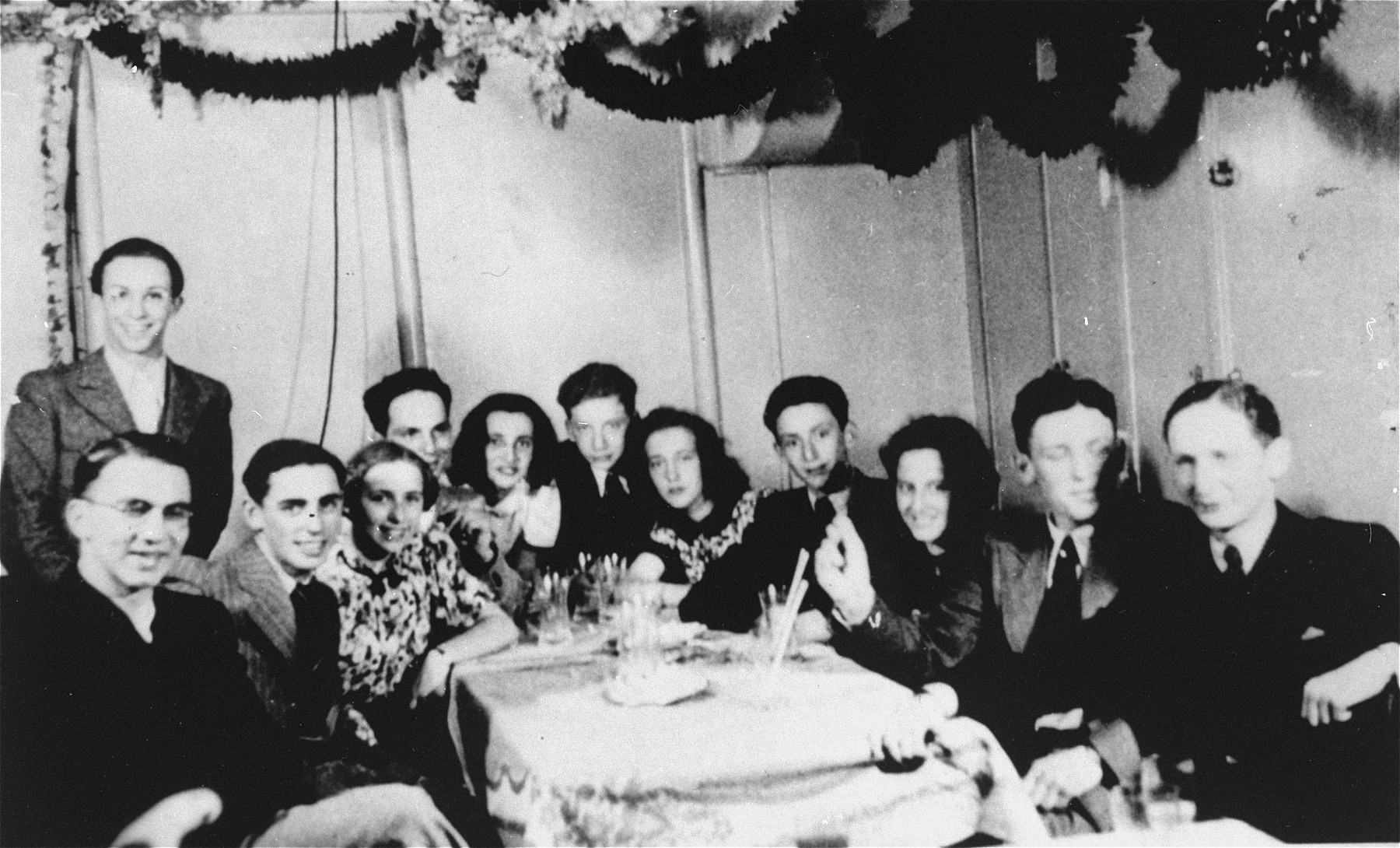 Teenagers at a party on the MS St. Louis.    Seated left to right are Ernst Weil, Jacques Ring, Fritz Buff, Sonja Knepel and Erich Spitz.