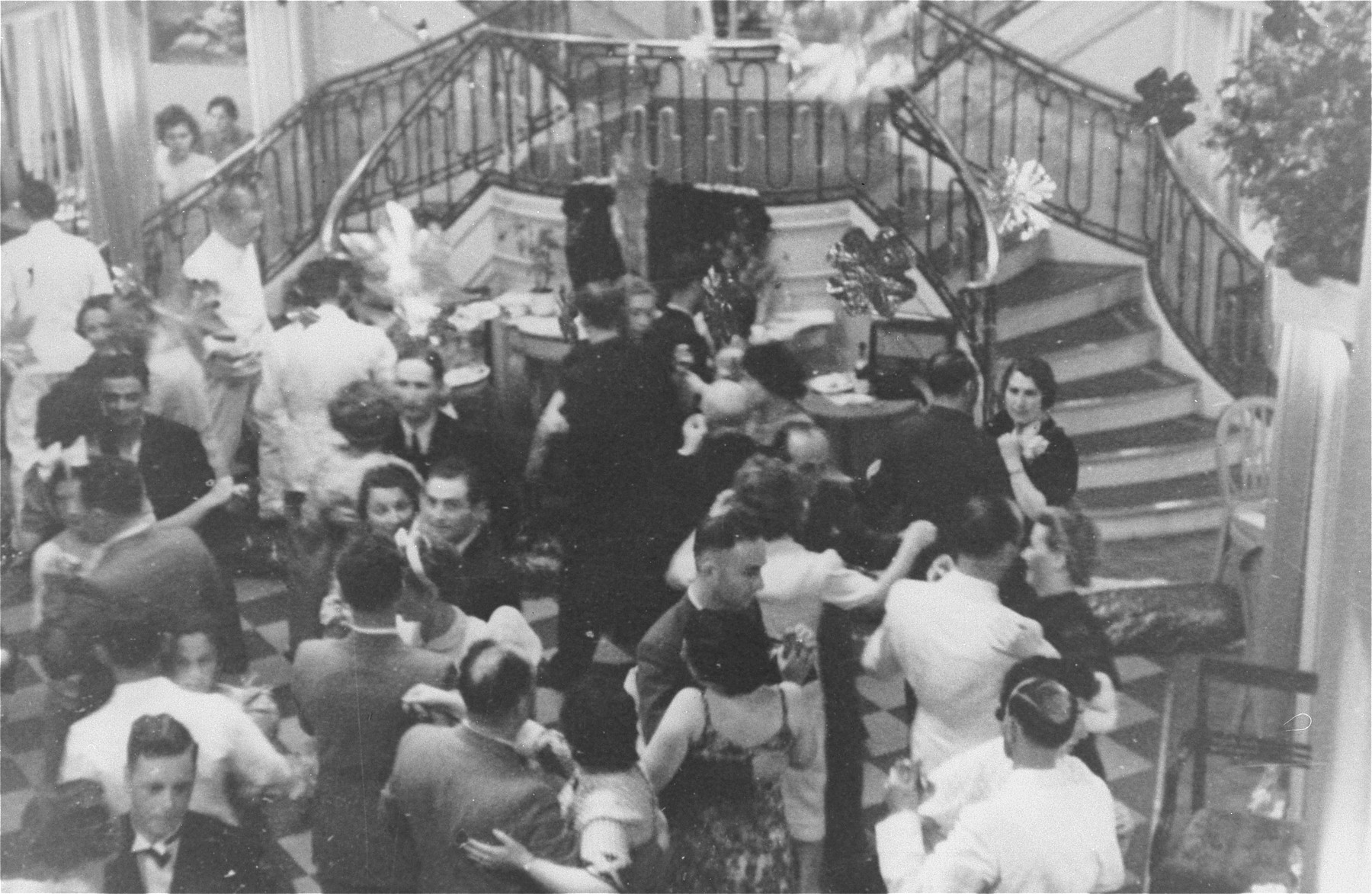 Refugees on board the MS St. Louis dance in the ship's ballroom.  Photo from the personal St. Louis photo album assembled by the donor's mother, Lotte Altschul.