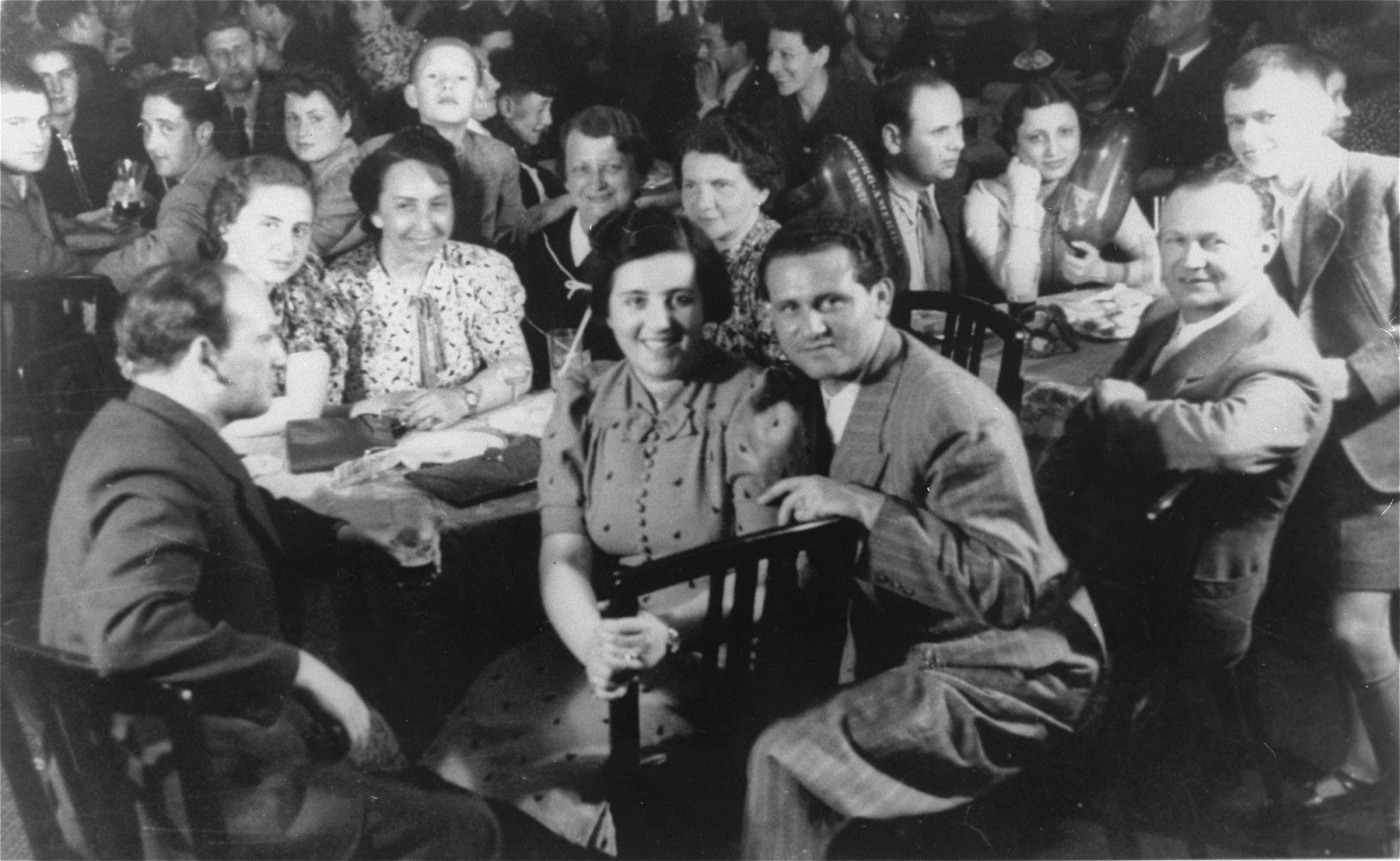 Passengers in the dining room of the MS St. Louis.    Pictured are Walter Weisler, Ursula Spitz, Erna Ring, Herbert Karliner, Margareth [last name unknown], Heinrich Glucksmann, Vera Spitz, Alfred and Sophie Aron, Walter Karliner, and Erich Ring.