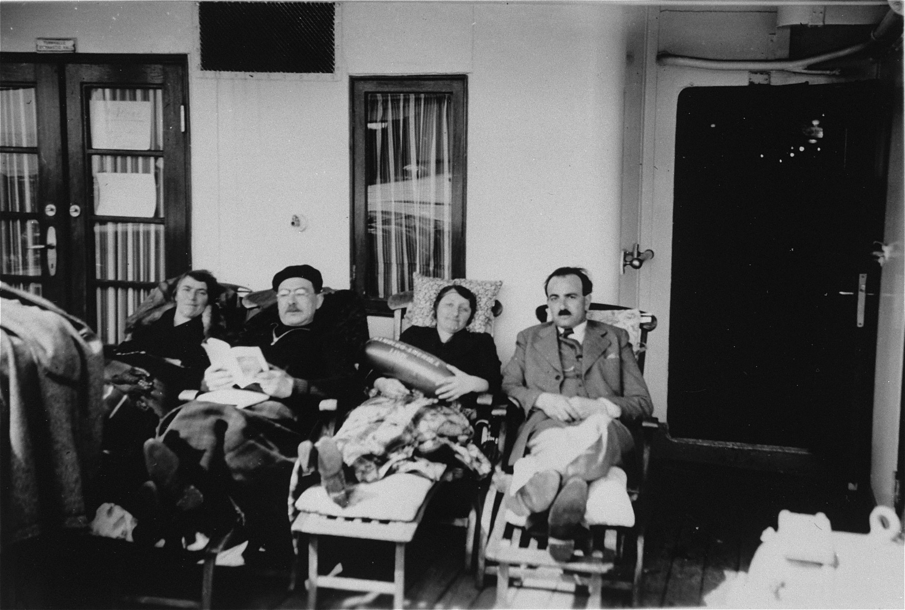 Passengers relax on the deck of the refugee ship MS St. Louis.     From a photo album belonging to St. Louis passenger Moritz Schoenberger.