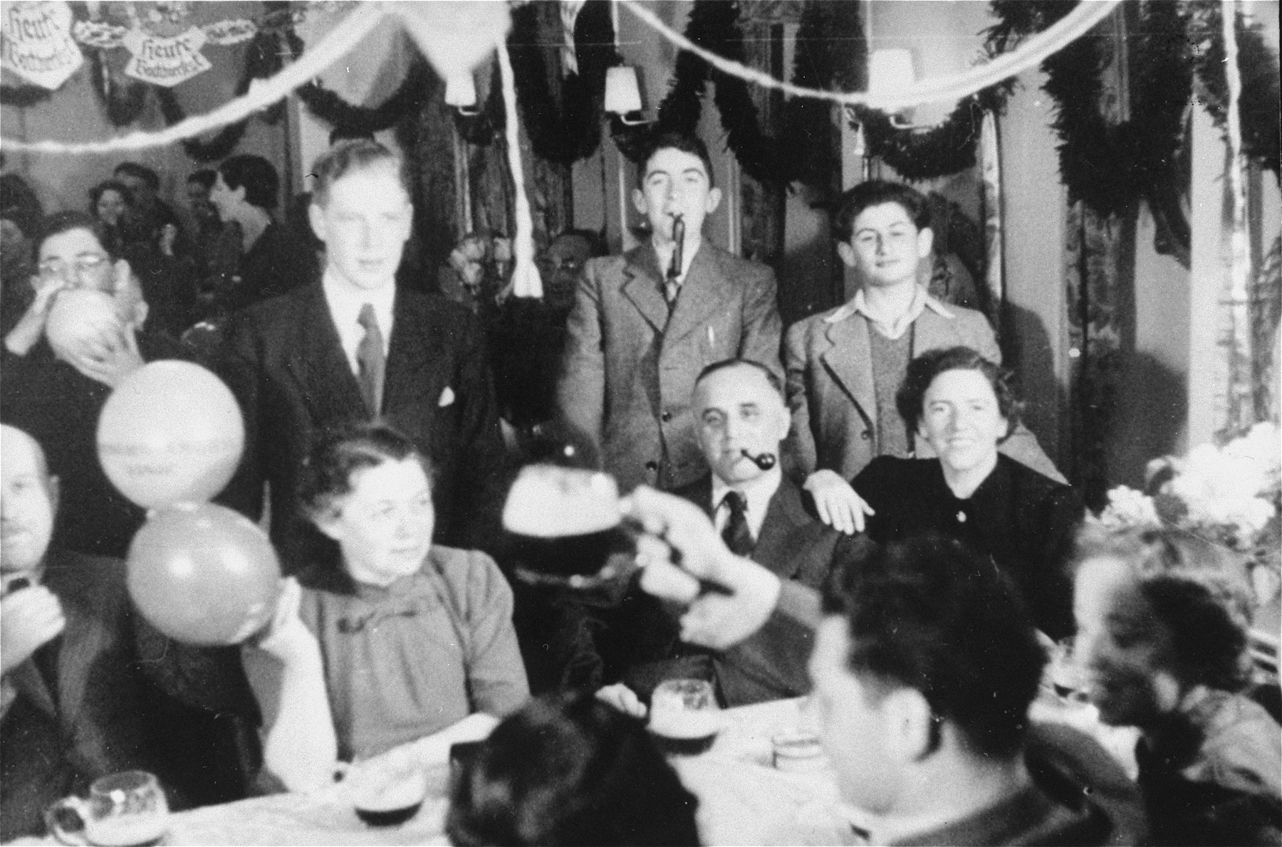 A party on board the MS St. Louis.   Among those pictured are Hermann and Rita Goldstein.