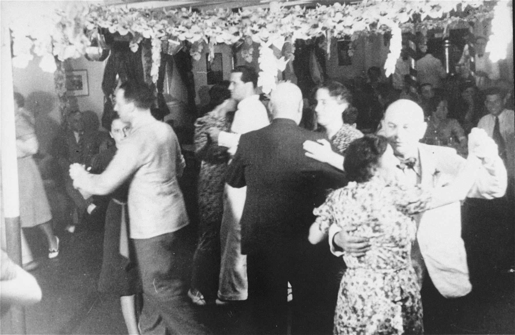 Passengers dancing on board the MS St. Louis.  Rita Goldstein is pictured at the lower right.