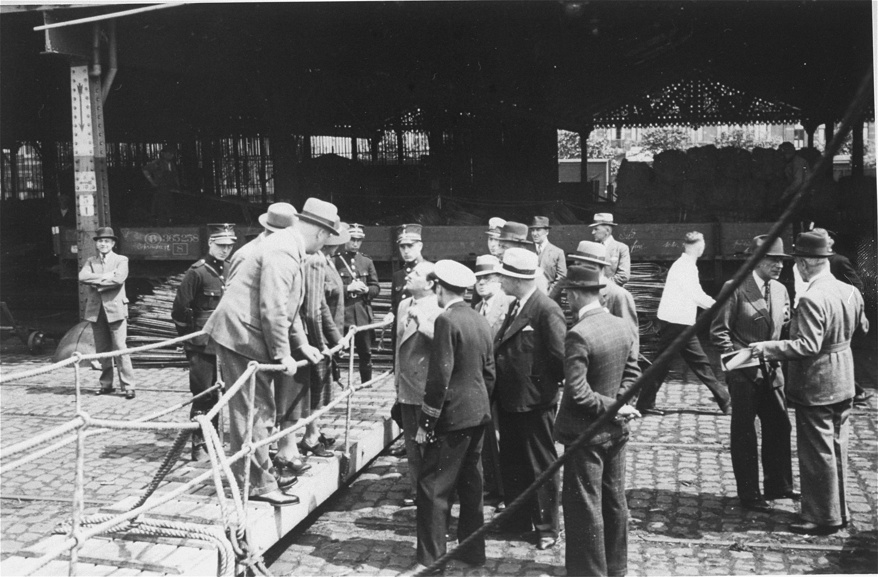 St. Louis Captain Gustav Schroeder negotiates landing permits for the passengers with Belgian officials in the port of Antwerp.