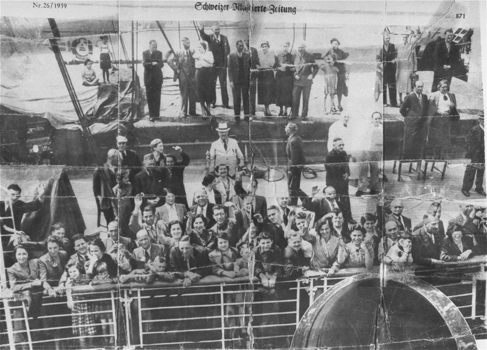 Passengers crowd the deck of the MS St. Louis.    Among those pictured is Ernst Weil (with glasses) waving from the deck.  Standing in the back on a raised section, the fifth and sixth people from the left are mother and daughter, Elly and Renate Reutlinger.
