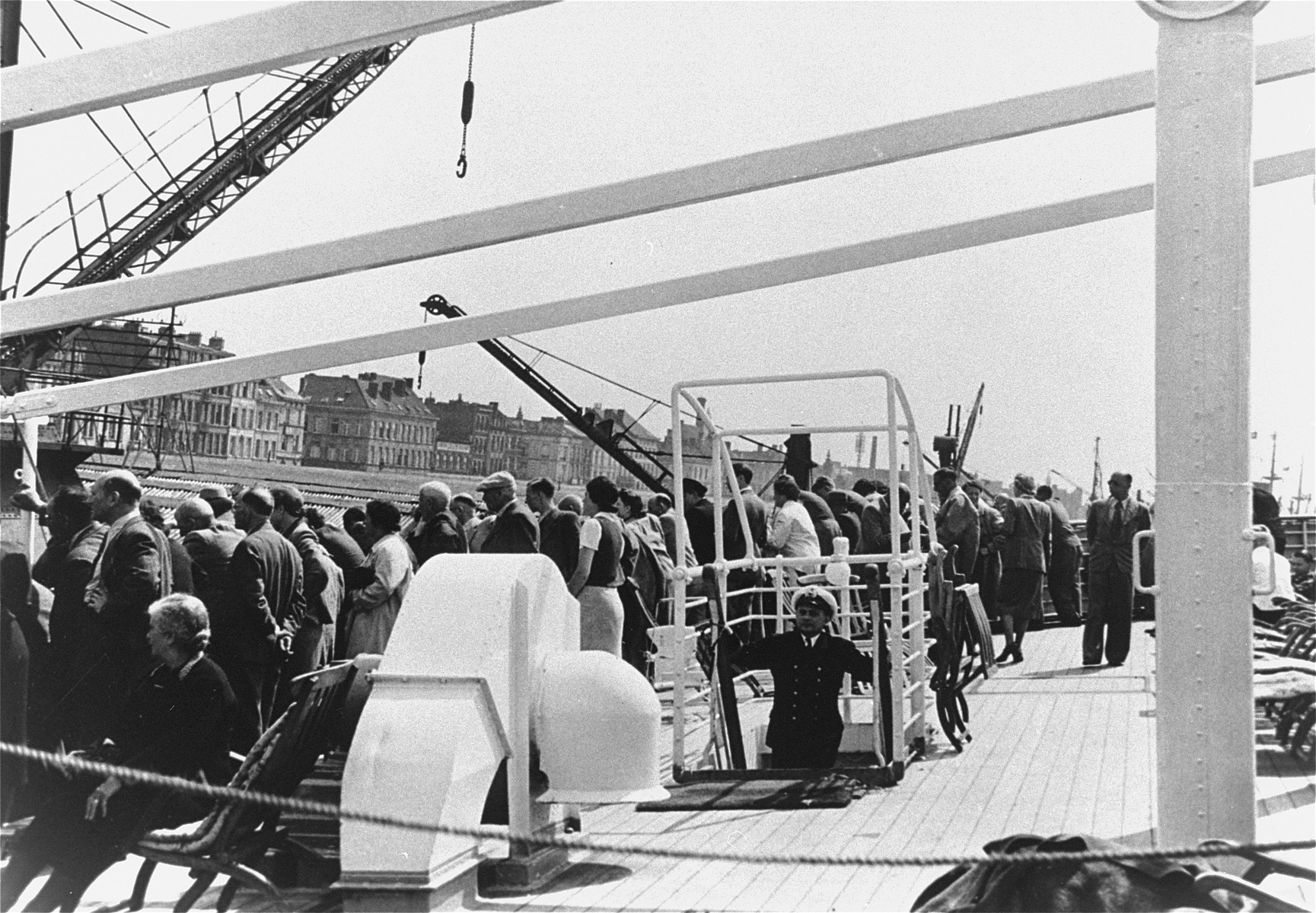 Passengers stand on the deck as the refugee ship the MS St. Louis arrives in the port of Antwerp.