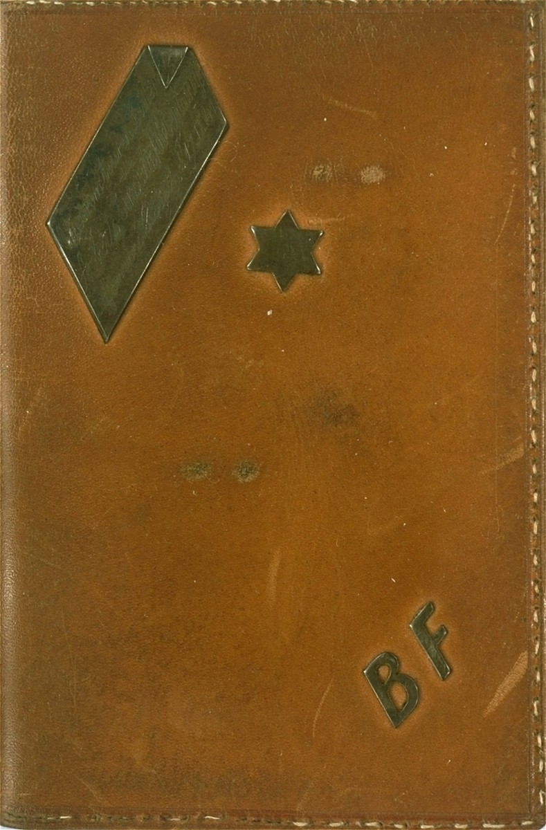 A leather covering of a pocket calendar for the year 1944, printed in the Lodz ghetto, with the initials B. F.  The calendar was owned by Bernard Fuchs, head of the employment office of the Lodz ghetto Jewish Council.