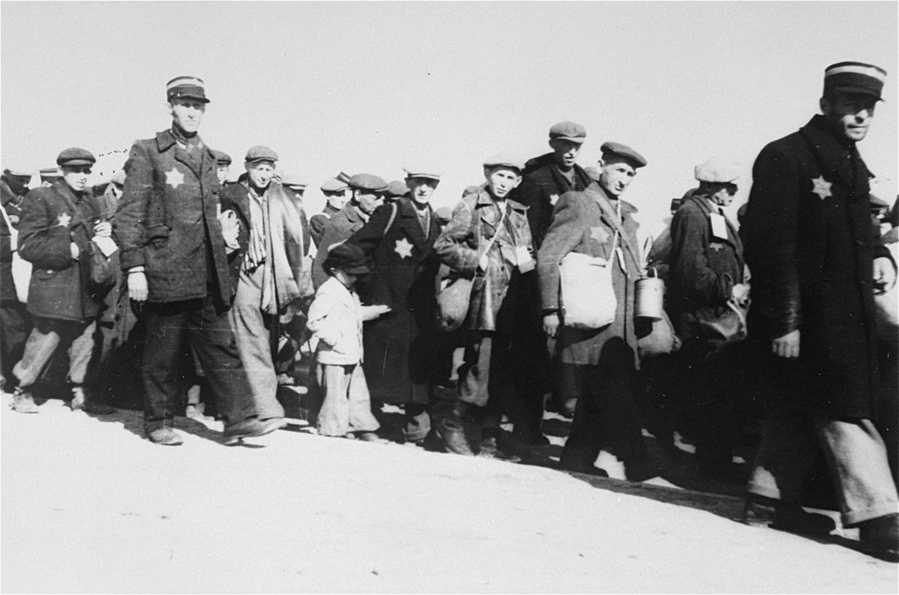 Jewish police escort a group of Jews who have been rounded-up for deportation in the Lodz ghetto.