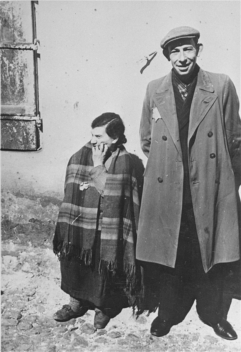 Portrait of a Jewish man and a woman in a street of the Lodz ghetto.