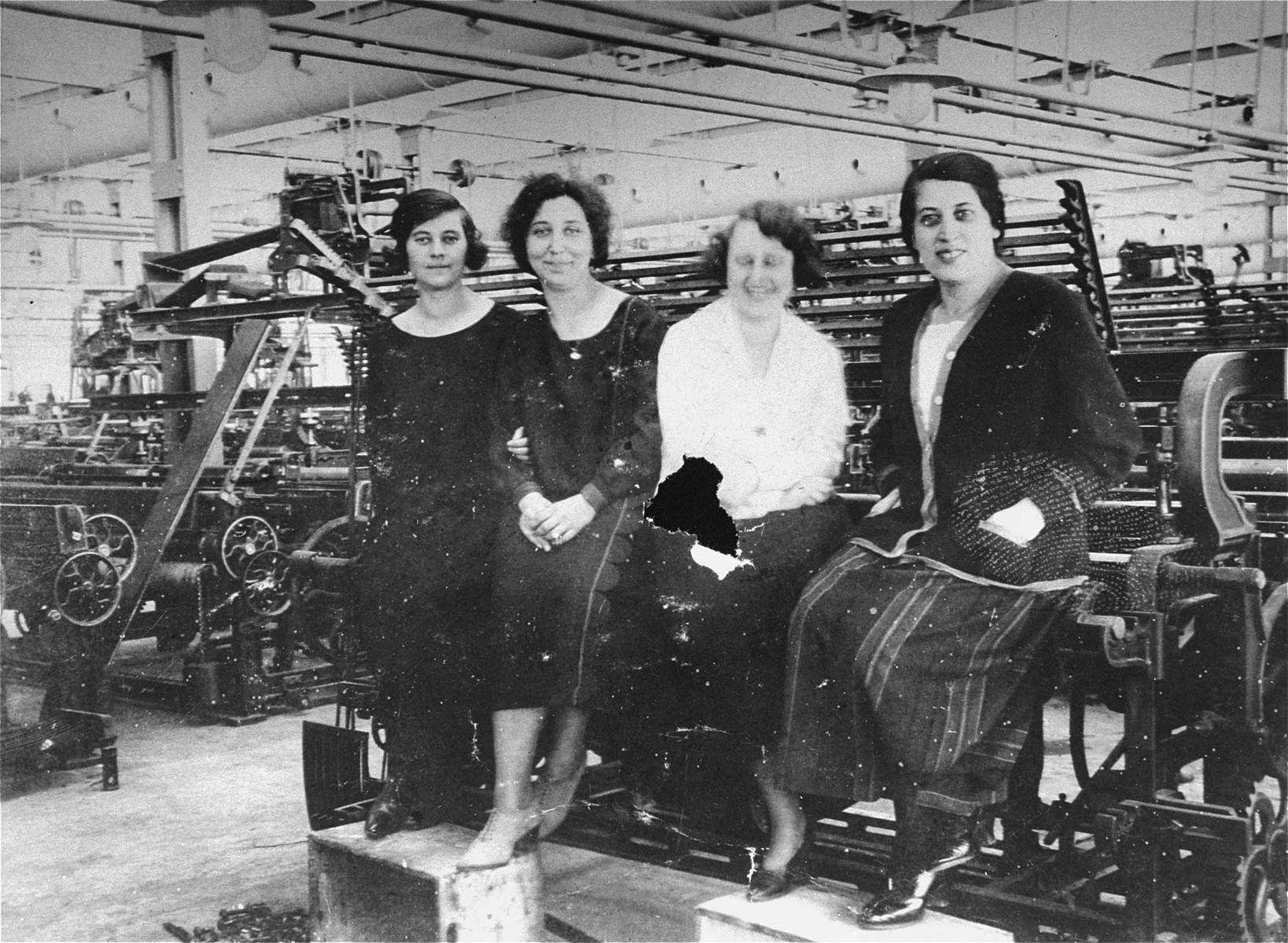 Four young Jewish female workers pose in the Goldberger textile factory in Budapest.    Among those pictured is Margit Kornhauser (wearing the white blouse).