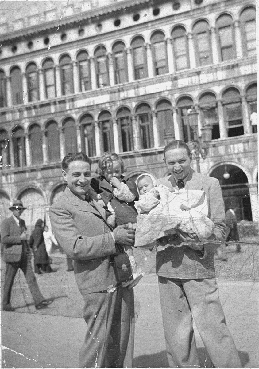 Two Jewish brothers on vacation in Italy.    Pictured at the left is Paul Barber with his child, and at the right, Gyorgy Barber with his infant.  Paul and Gyorgy Barber are the uncles of Karoly Barber.