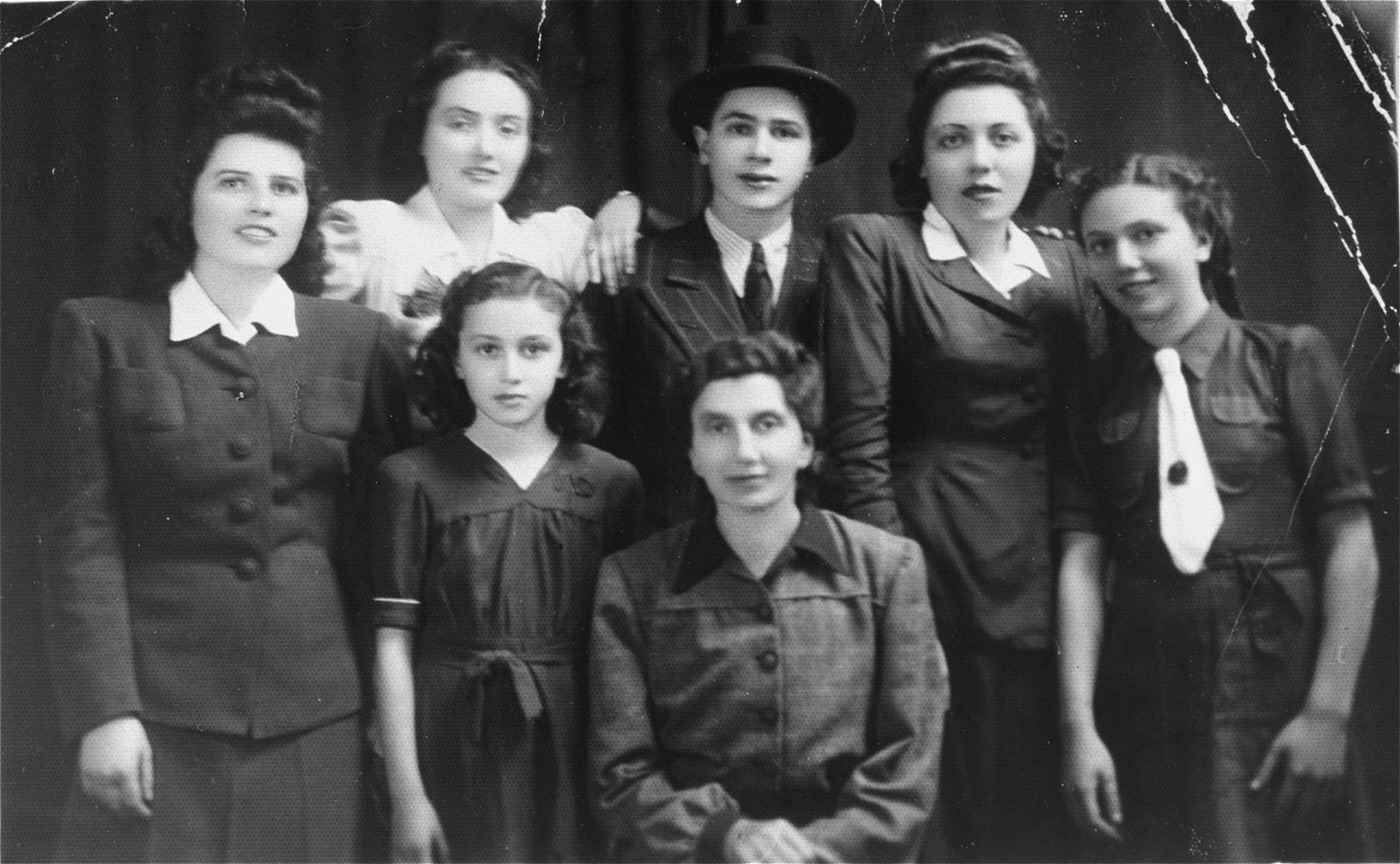 Group portrait of members of the Katz family in Munkacs.  Pictured in the bottom row (from left to right) are: Helen and Tereza Katz; top row: Chicha. Isabella; Philip, Jolon (Cipi) and Regina Katz.