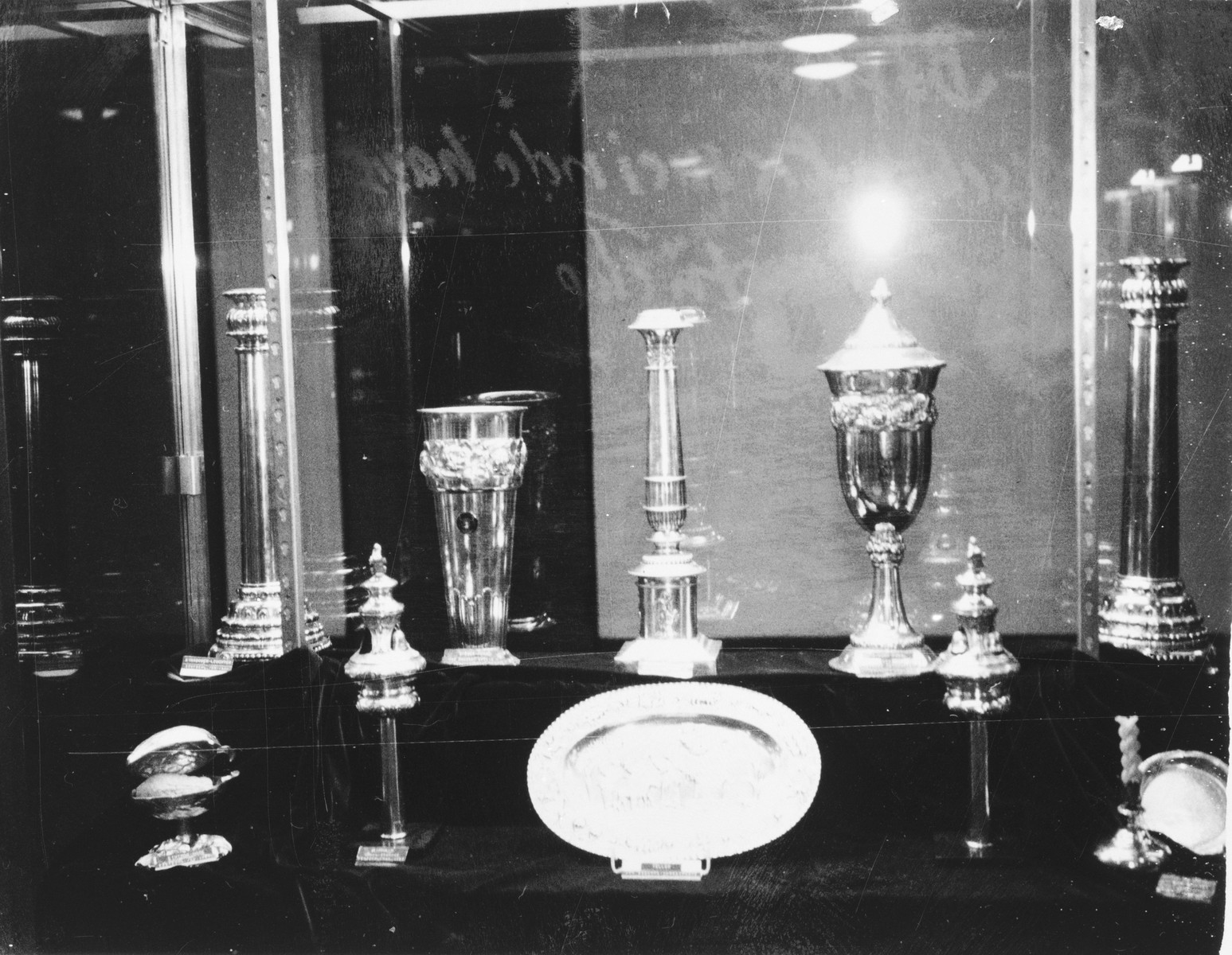 Display of synagogue silver from Berlin that was retrieved from an underground hiding place after World War II.