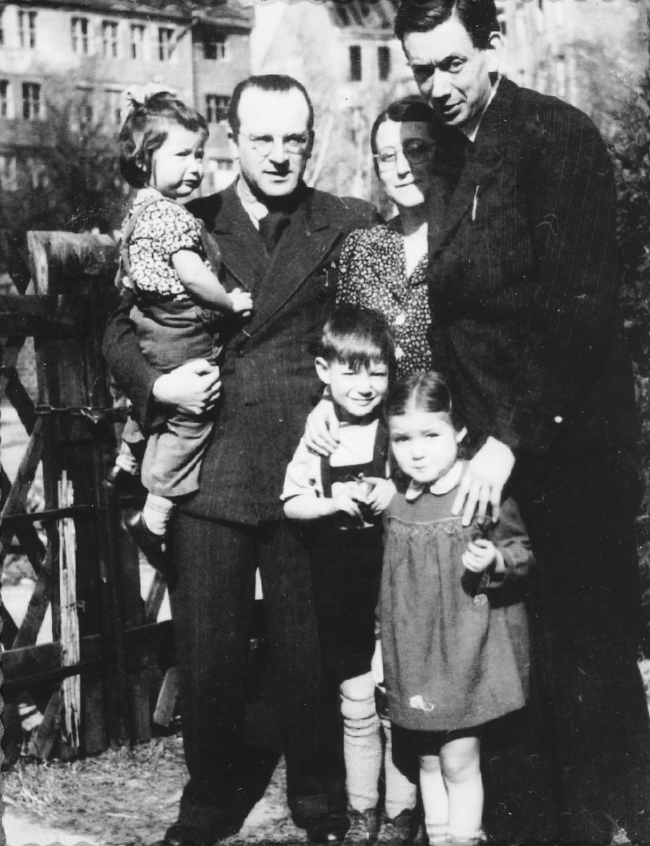 DP leader Norbert Wollheim poses with the Fabian family.  Pictured standing in front, from left to right, are: Joel and Judis Fabian.  Behind them, from left to right, are: Reha Fabian, Norbert Wollheim, Ruth Fabian and Hans Fabian.