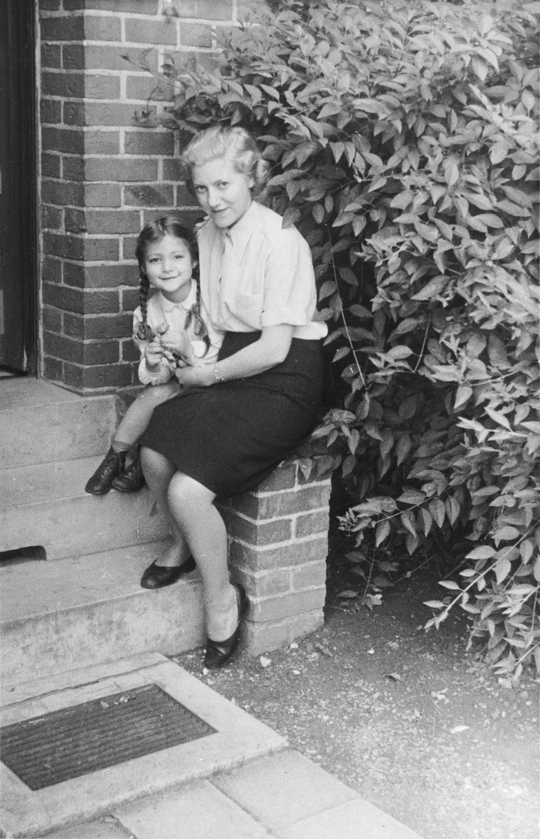 Friedel Wollheim, second wife of DP leader, Norbert Wollheim, poses with Judis Fabian on the steps of her home in Luebeck, Germany.