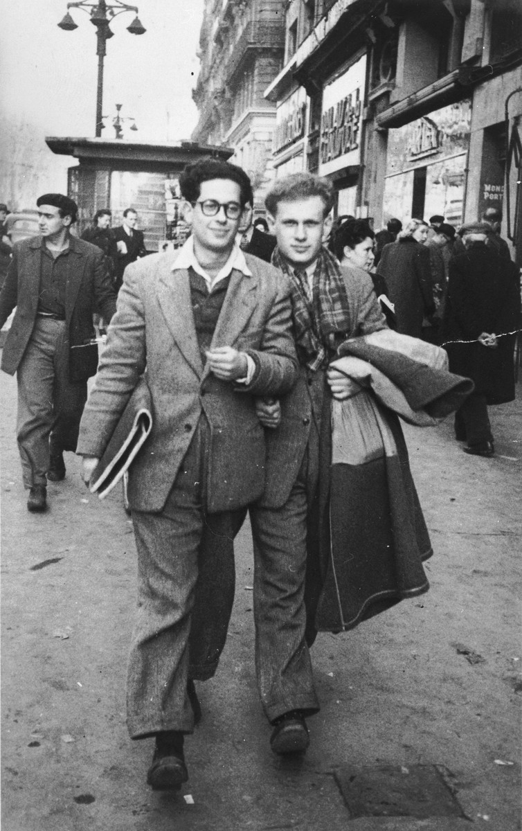 Two Jewish DP youth who numbered among the Exodus 1947 passengers, walk along a street in Marseilles before their departure for Palestine.  Pictured are Benno Ginsburg (right) and Jacques Rabinovich (left).