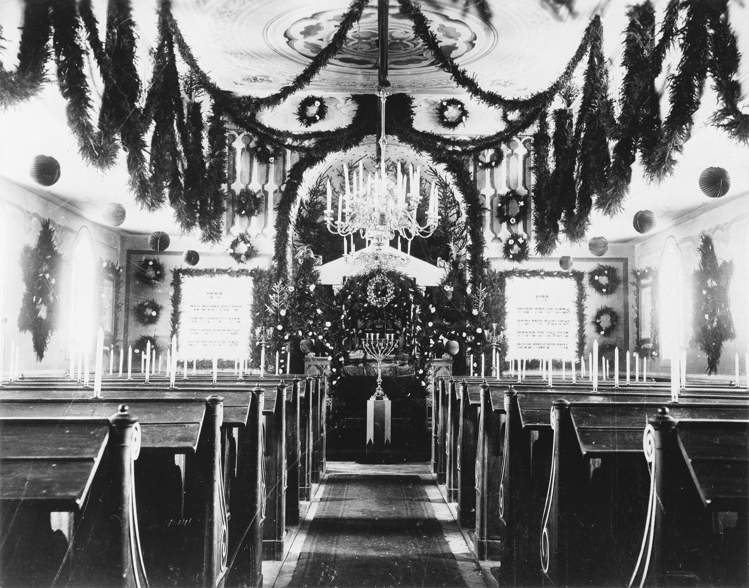 View of the sanctuary in the Buttenwiesen synagogue that is decorated with evergreens for the winter season.  The synagogue in Buttenwiesen was not destroyed during Kristallnacht.  After the war it was converted into a school and later used for other purposes.