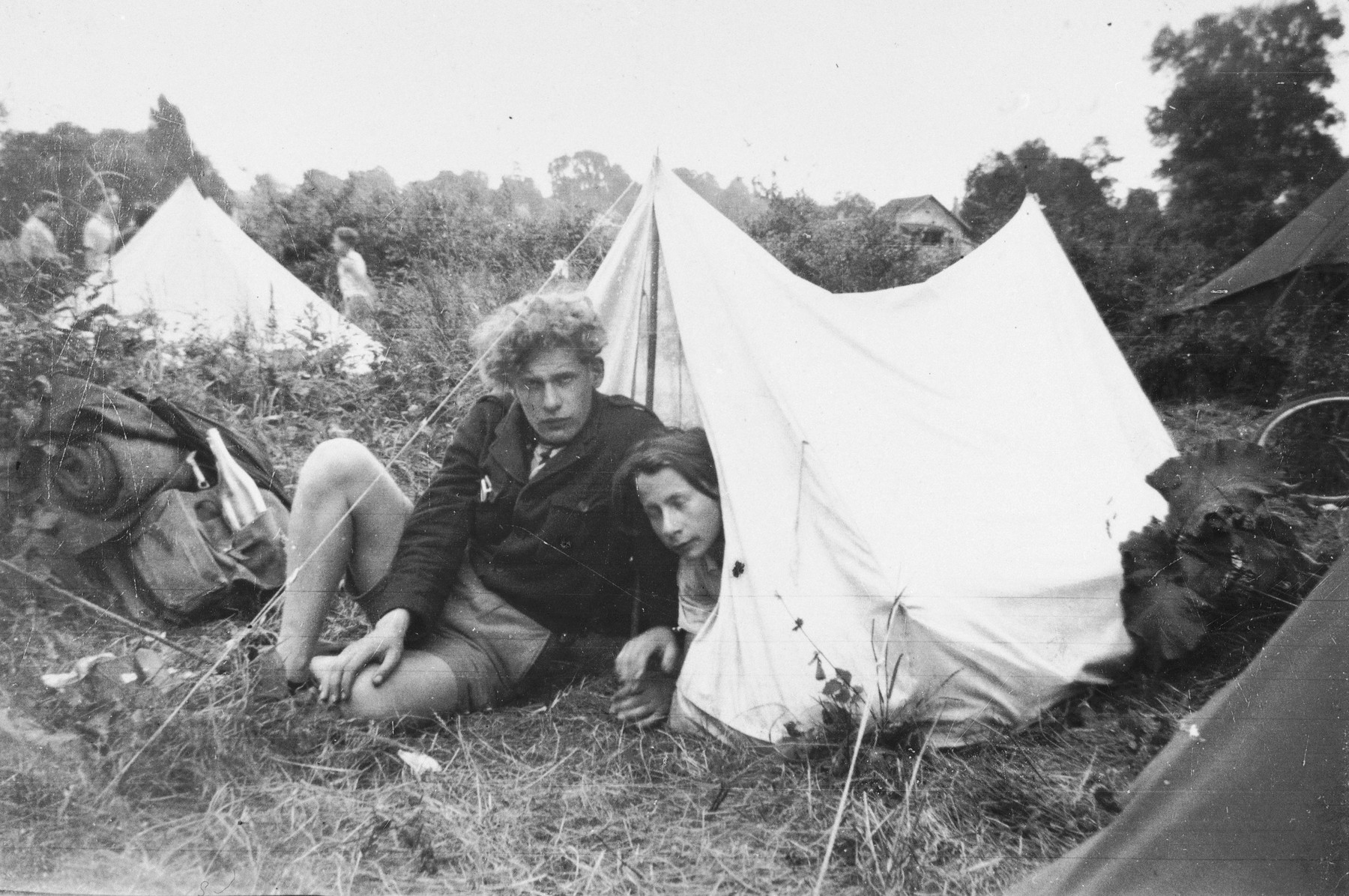 Benno Ginsburg (left) poses with a friend in front of their tent at a hachshara (Zionist collective) in Toulouse.