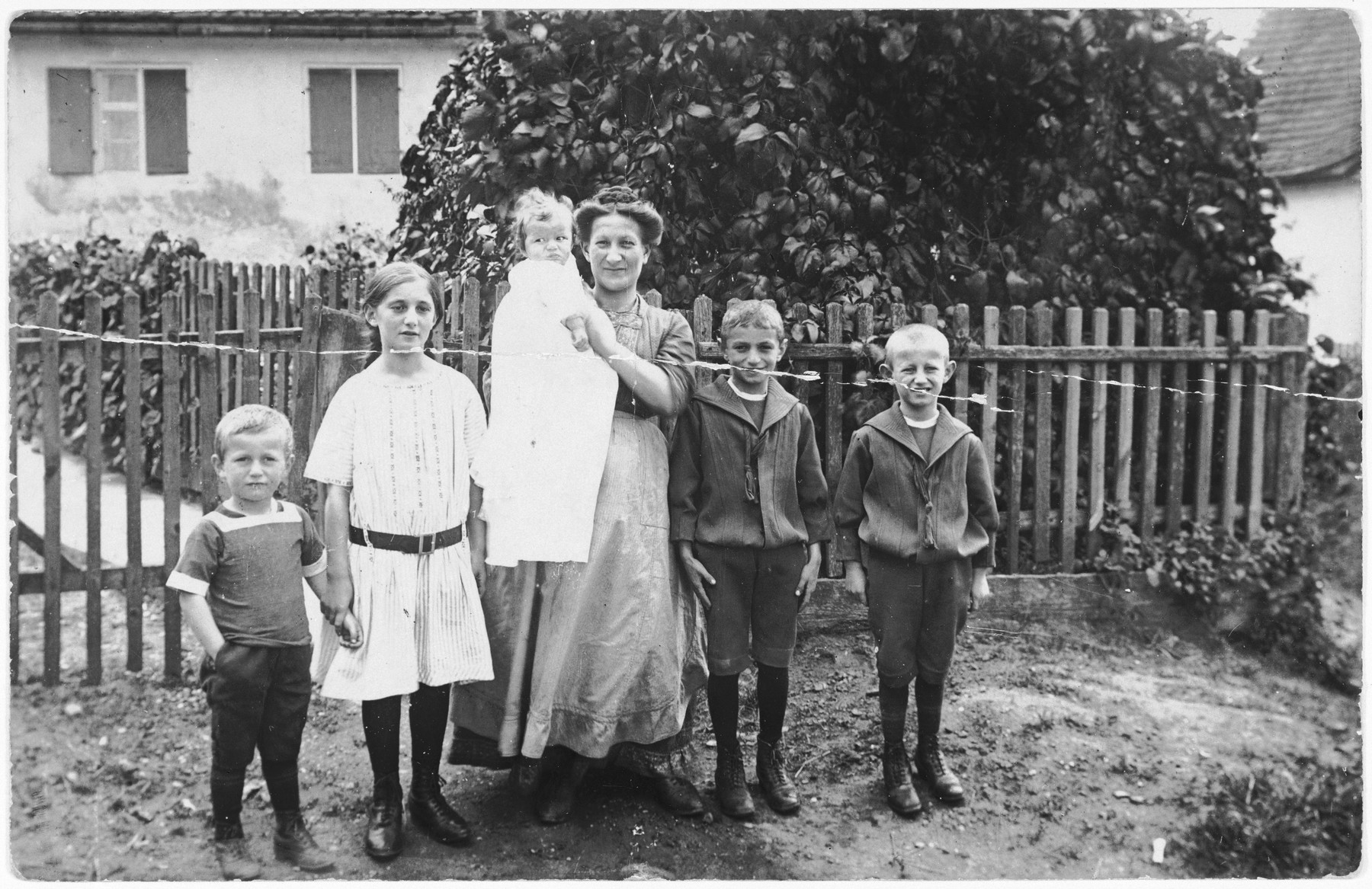 Theresa Frank poses with her five children outside her home in Buttenwiesen, Germany.  Pictured from left to right are: Ernst, Hedwig, Ludwig, Theresa, Siegfried and Karl Frank.  Of those pictured only Siegfried survived.