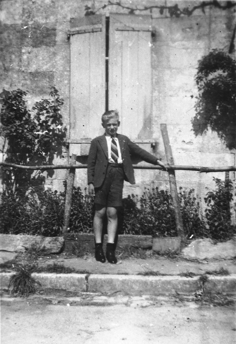 Benno Ginsburg poses outside while living in hiding on the farm of Adrian and Marie Puyrajoux in France.