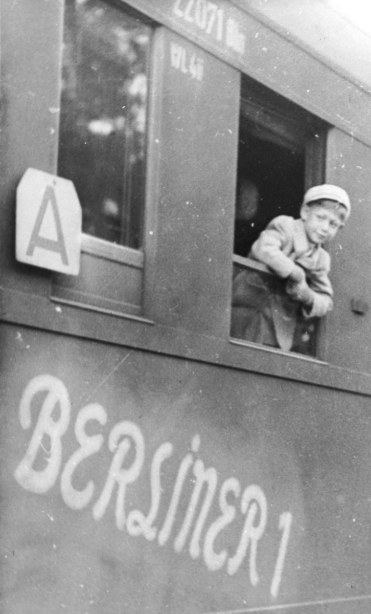Joel Fabian looks out the window of a train as he leaves Berlin for a sanatorium in Davos, Switzerland, where he will be treated for the tuberculosis he contracted while imprisoned in Theresienstadt..
