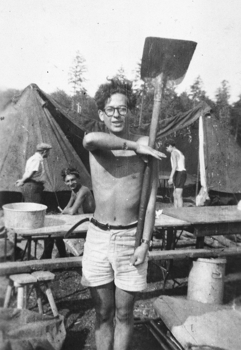Jacques Rabinovich practices military exercises with a shovel at the Poppendorf displaced persons camp.