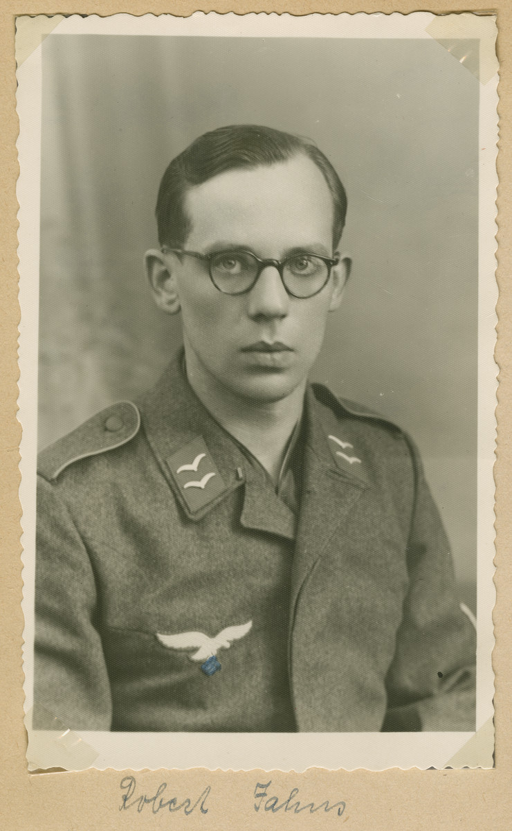 A studio portrait of a Nazi soldier. The name is written as, 'Robert Fahus.'    (The swastika under the eagle was blacked out with a pen.)