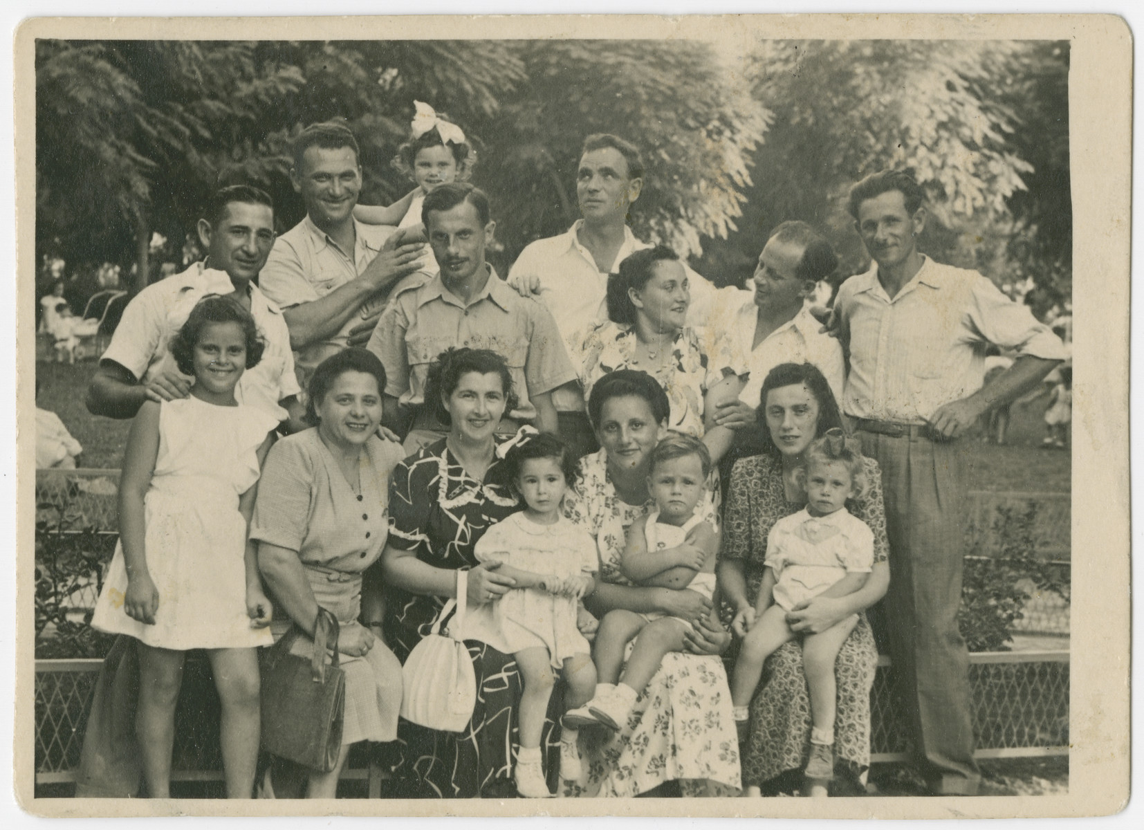 Group portrait of some former Bielski partisans in Israel.  Yehuda Bielski is standing on the far right.  His wife Lola, holding their daughter Nili,  is seated on the far right.  Tuvia Bielski is standing second from the left holding his daughter Ruth, and Zus Bielski is standing in the back center.  Eli Hudes (Lola's brother) is standing between Tuvia and Zus.