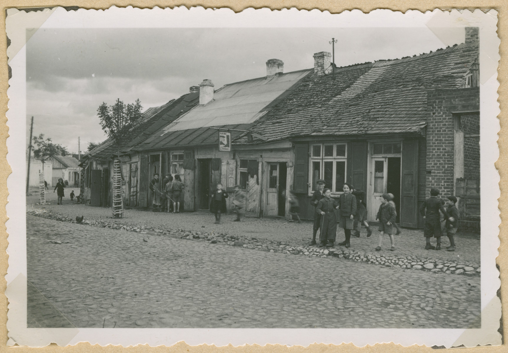Children play in the street of an unidentified Polish town [probably in the Lublin region].