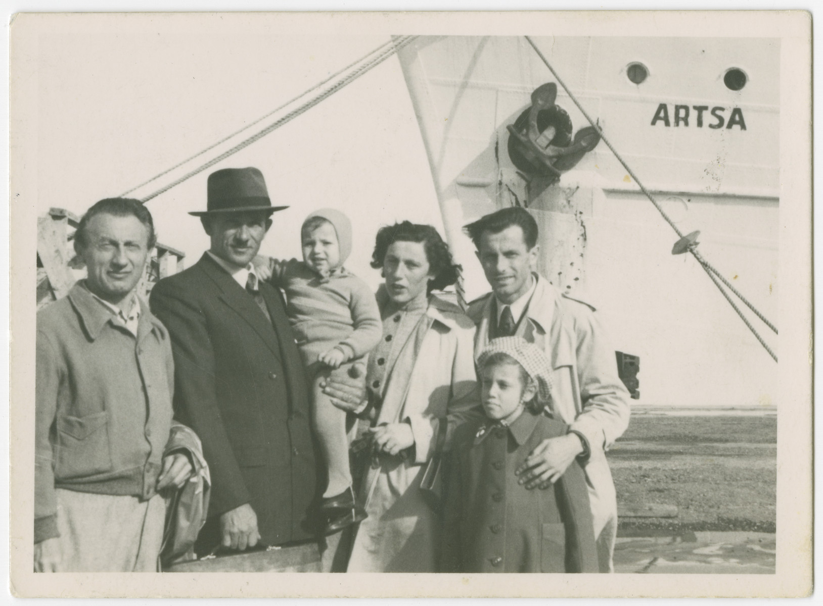 The family of Yehuda Bielski prepares to sail from Israel to the United States.  From left to right are Marcus Hudes (unlce of Lola), Yehuda holding his son Yigal, Lola, and Eli Hudes (Lola's brother).  Nili Bielski is in front of him.