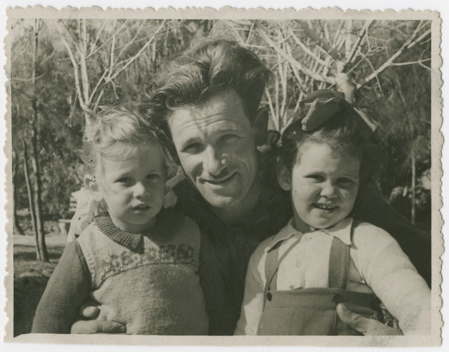 Yehuda Bielski poses with his daughter Nili and his cousin's daughter Ruth.
