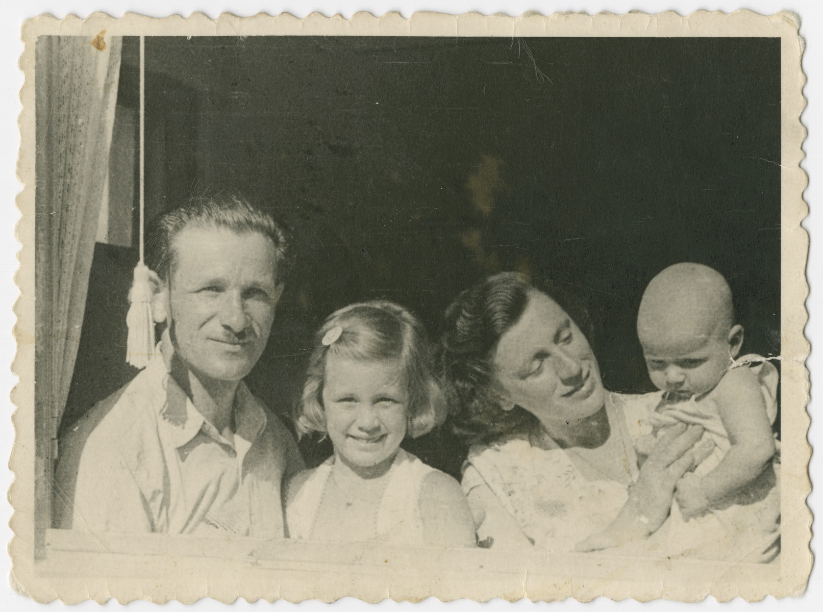 The family of Yehuda Bielski looks out the window of their home in Israel.  From left to right are Yehuda, Nili, Lola and Yigal Bielski.