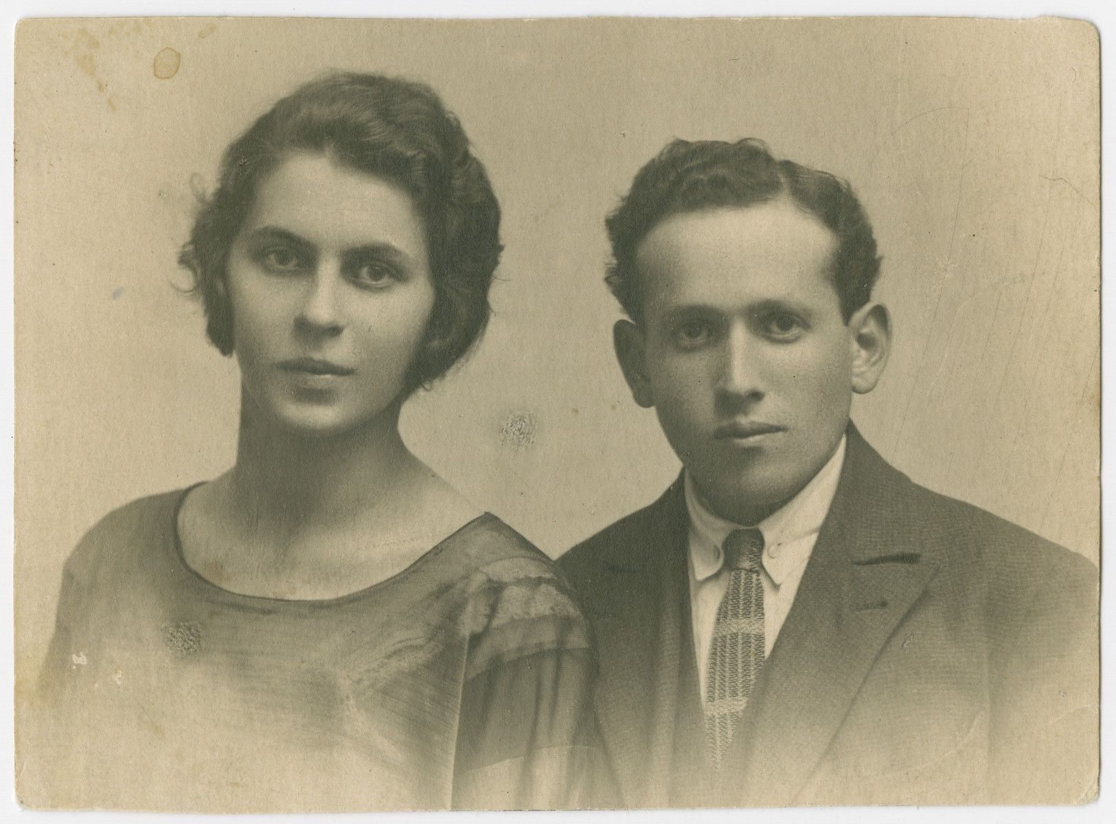 Studio portrait of Eva Hudes Fishman (sister of  Lola Hudes Bielski) and her husband, Lazar Fishman.  They and their three children all perished in Majdanek.