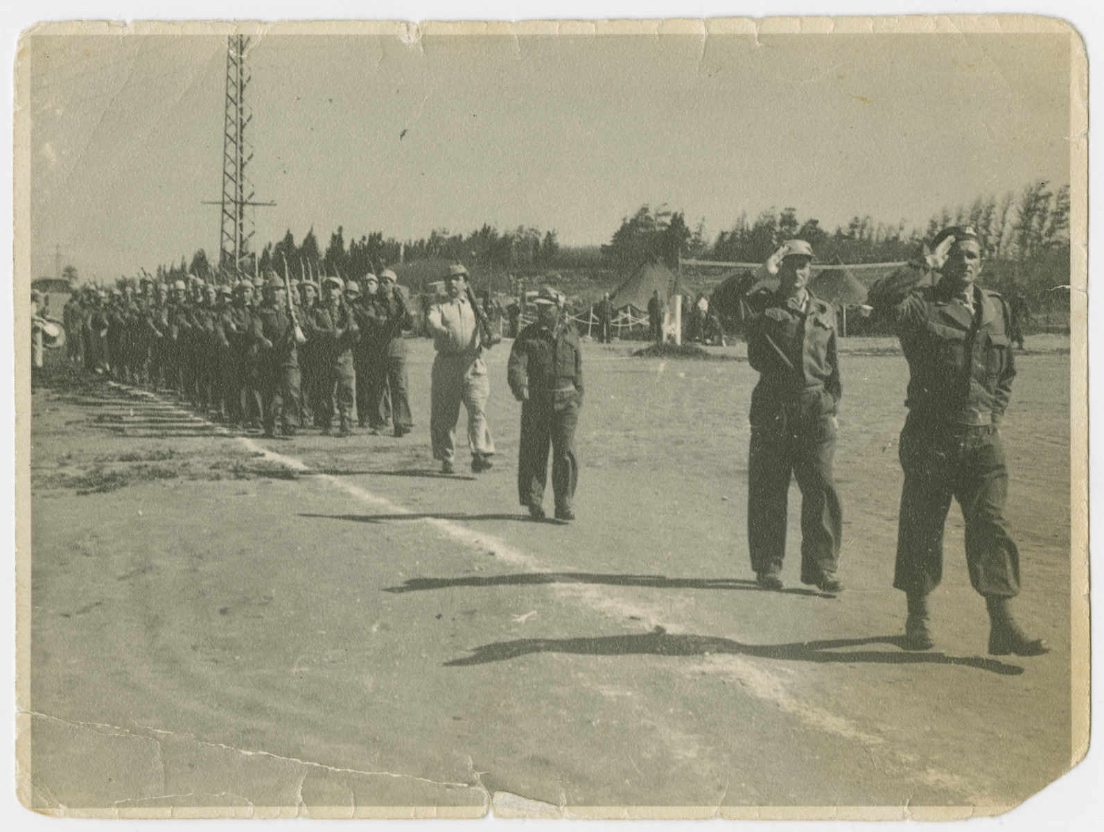 Lt. Yehuda Bielski (front right) leads his unit on parade.
