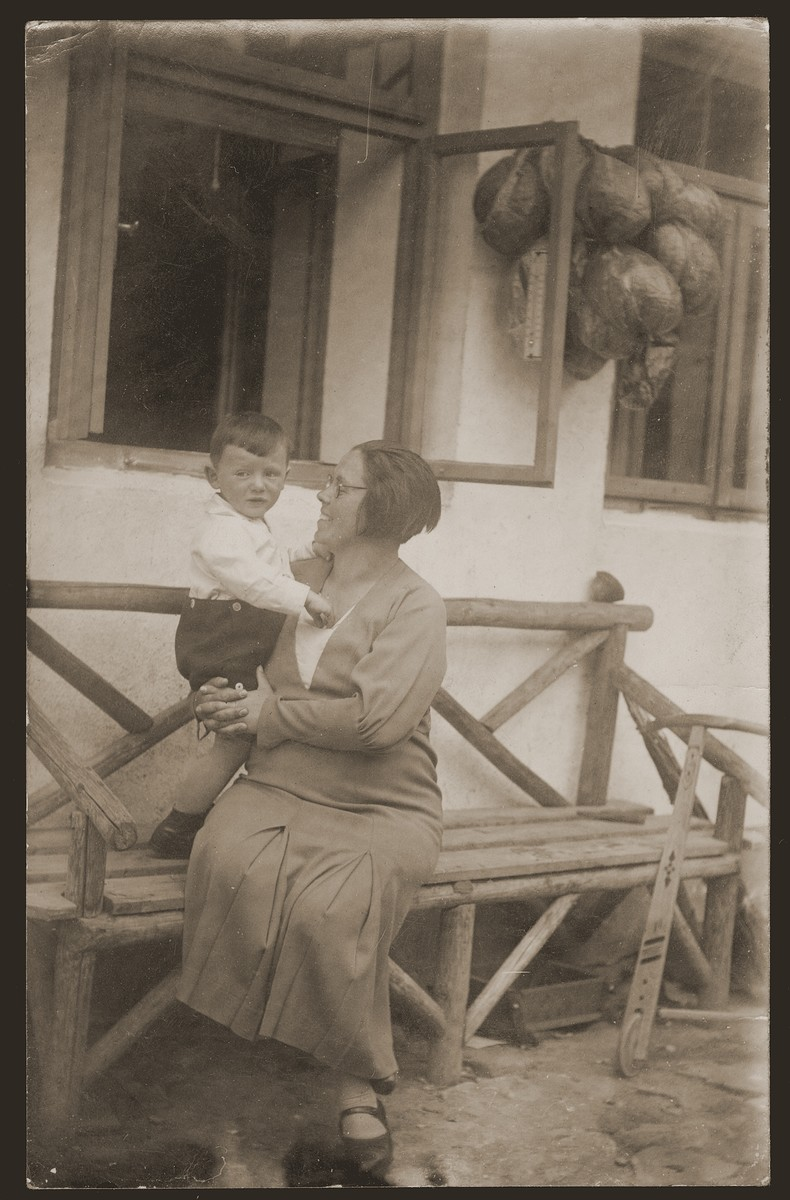 Marie Klepetar sits outside her home with her son, Ivo.