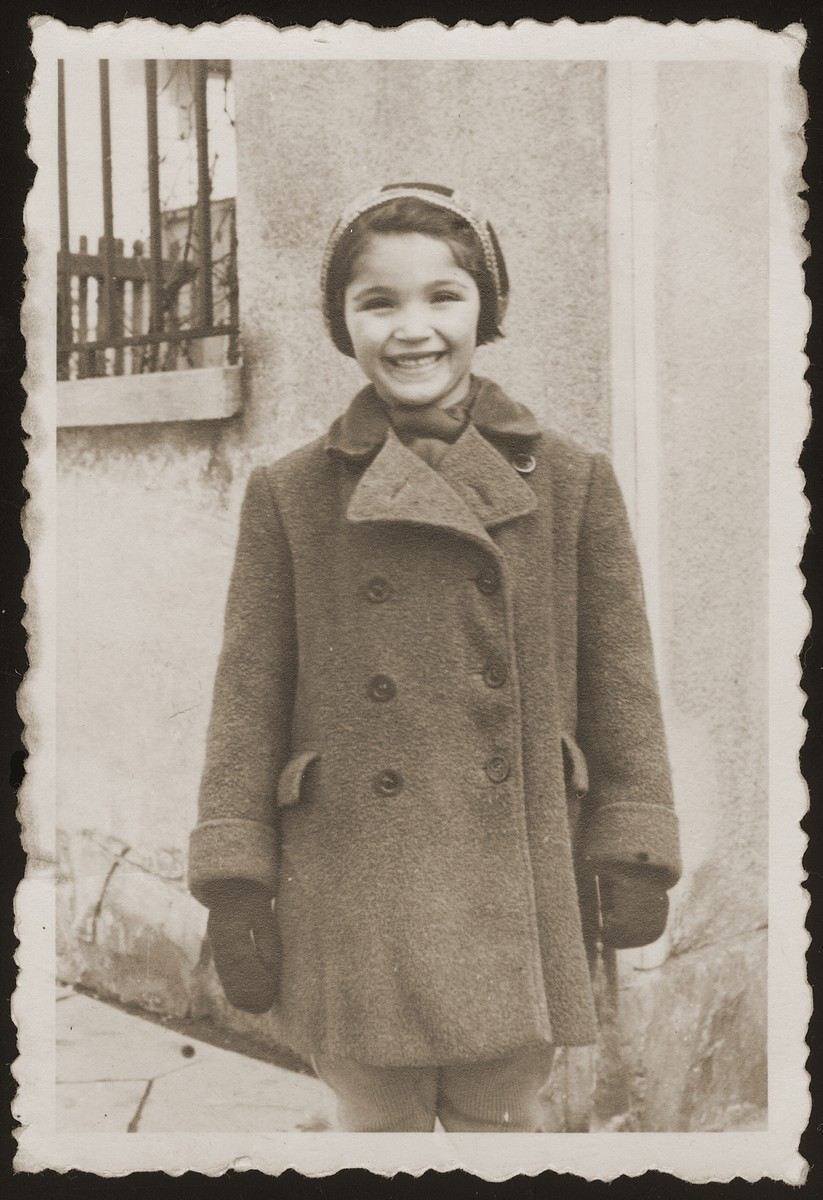 Portrait of Eva Goldstein outside her home in Olomouc, Czechoslovakia.    Bohus and Wilma (Redlich) Goldstein had two children, Eva and Michael.  The family lived in Olomouc, where Bohus worked for the Prague autoworks.  All four perished during the war.